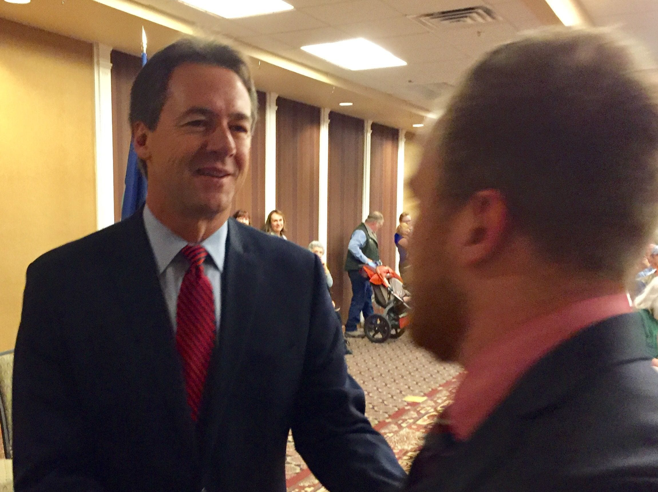 Gov, Steve Bullock, left, congratulates a state employee at an event Monday honoring excellence in performance.  Photos by Tribune photo/Phil Drake Gov, Steve Bullock, left, congratulates a state employee at an event Monday honoring excellence in performance.