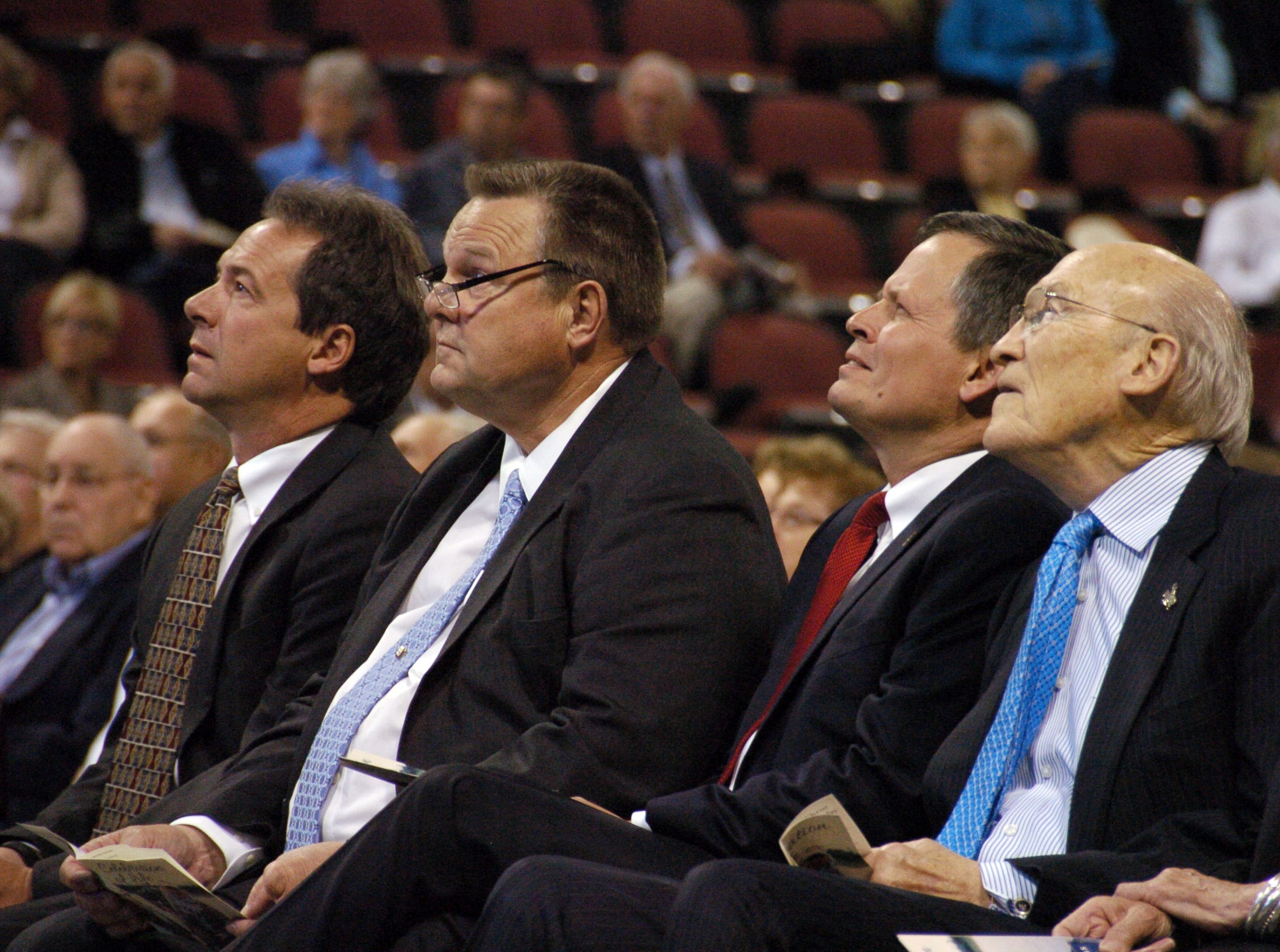 AP Photos/Matthew Brown From left, Montana Gov. Steve Bullock, Montana U.S. Sens. Jon Tester and Steve Daines and former Wyoming U.S. Sen. Alan Simpson watch a slideshow depicting the life of former Montana U.S. Sen. Conrad Burns during Burns? funeral service on Friday. From left, Montana Gov. Steve Bullock, Montana U.S. Sens. Jon Tester and Steve Daines and former Wyoming U.S. Sen. Alan Simpson, watch a slide show depicting the life of former Montana U.S. Sen. Conrad Burns during Burns' funeral service on Friday, May 6, 2016, at the Metra Park Arena in Billings, Mont. Tester narrowly defeated Burns in 2006. Burns died last week at the age of 81.   (AP Photo/Matthew Brown)