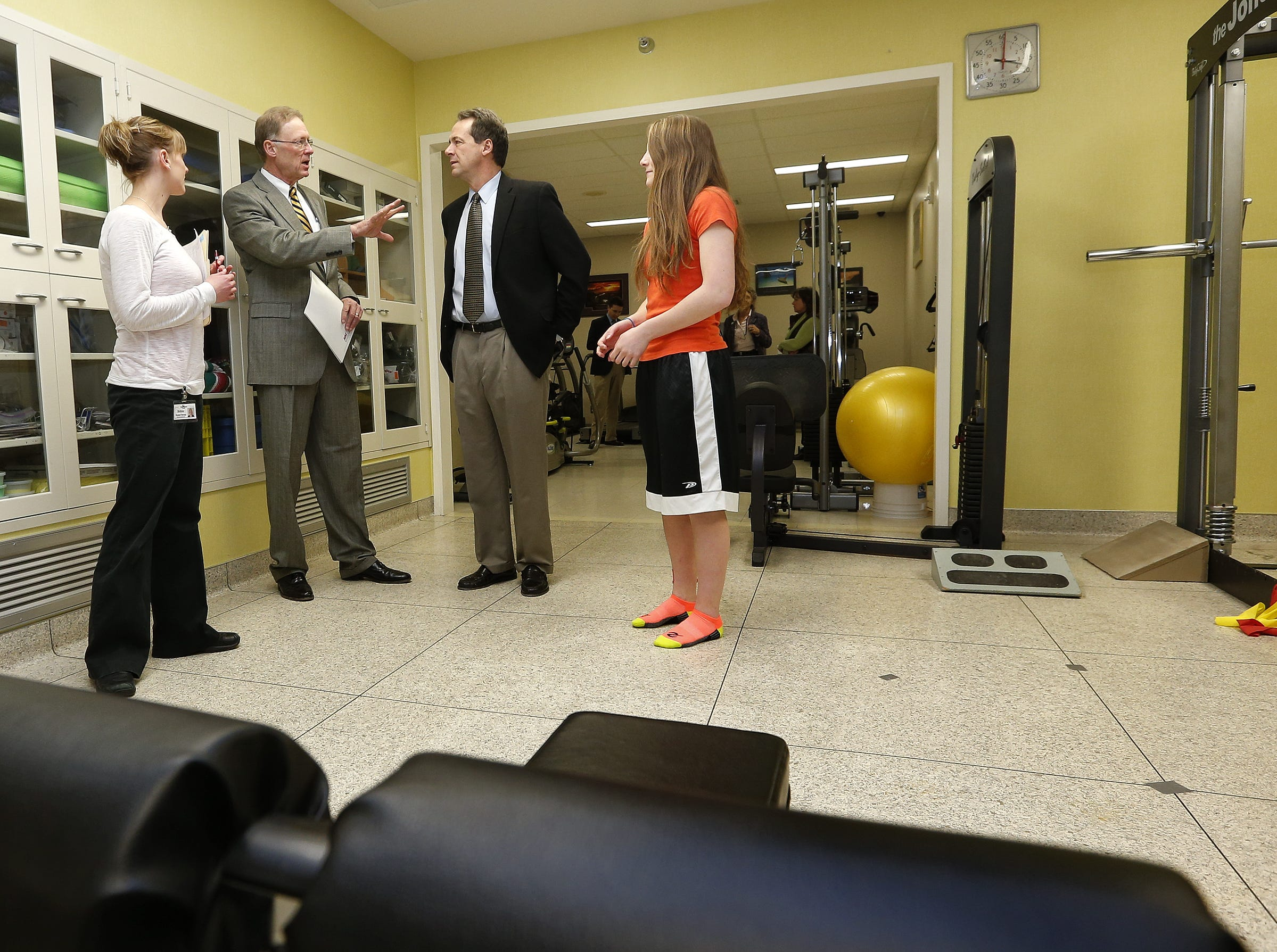 TRIBUNE PHOTO/LARRY BECKNER Louie King, CEO of Teton Medical Center, second from left, gives Gov. Steve Bullock a tour of the physical therapy department at the hospital in Choteau on Thursday, as Brittnie Herbst, left, and Katie Kostelnik look on. Louie King, CEO of Teton Medical Center, second from left, gives Gov. Steve Bullock a tour of the physical therapy department at the hospital in Choteau Thursday, as Brittnie Herbst, left, and Katie Kostelnik look on.