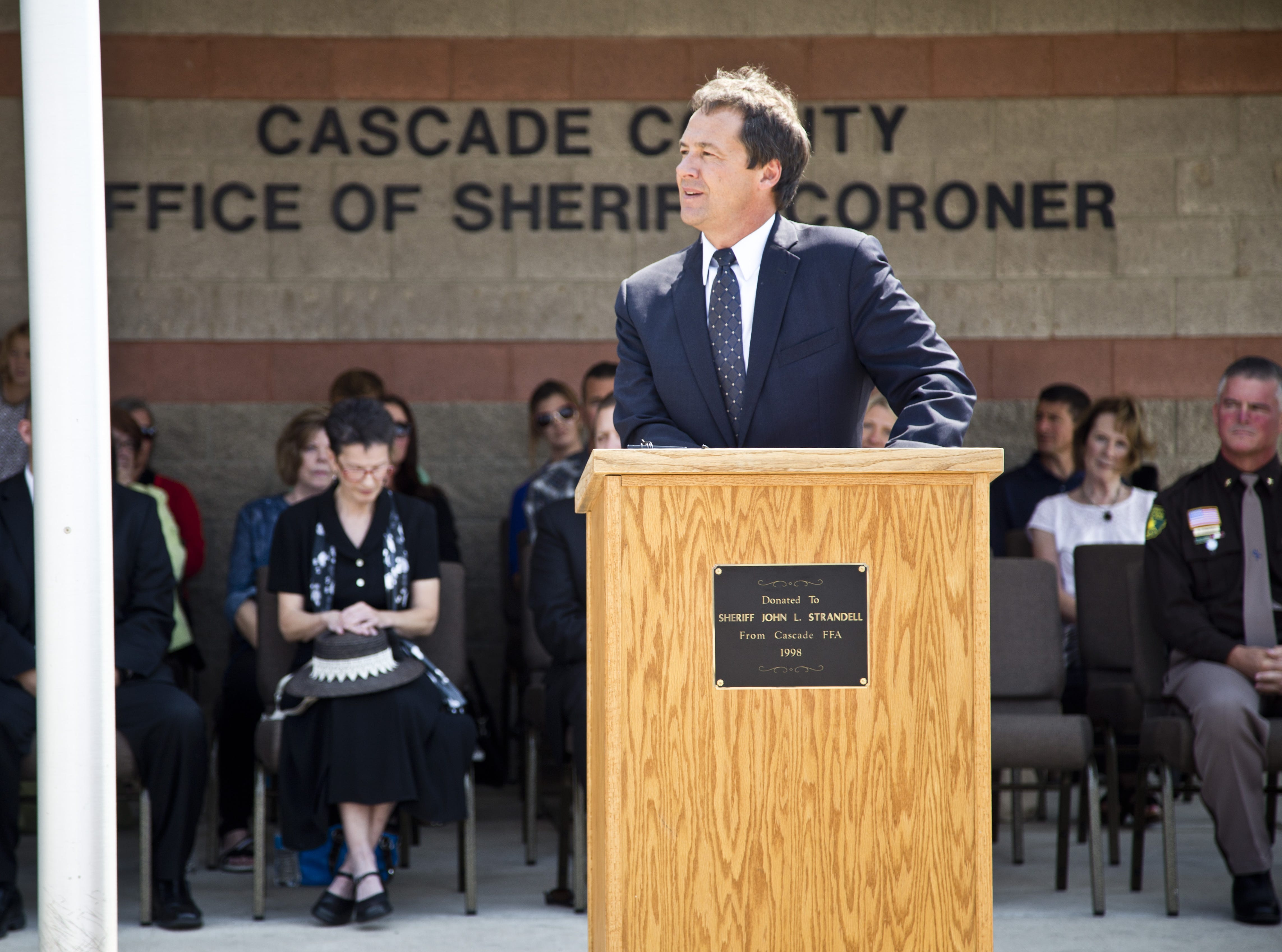 Tribune photo/Annisa Keith Gov. Steve Bullock speaks during the Joseph Dunn highway dedication ceremony Wednesday.  Bullock faced away from the crowd during his speech to make condolences to Dunn?s family. Gov. Steve Bullock speaks during the Joseph Dunn highway dedication ceremony on Aug 19 at the Cascade County Sheriff's Office. Bullock faced away from the crowd during his speech to make condolences to Dunn's family. Tribune photo/Annisa Keith