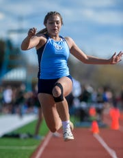 Great Falls High's Kaitlyn Gilbert competes in the long jump during the crosstown track meet between C.M. Russell High and Great Falls High on Tuesday at Memorial Stadium.