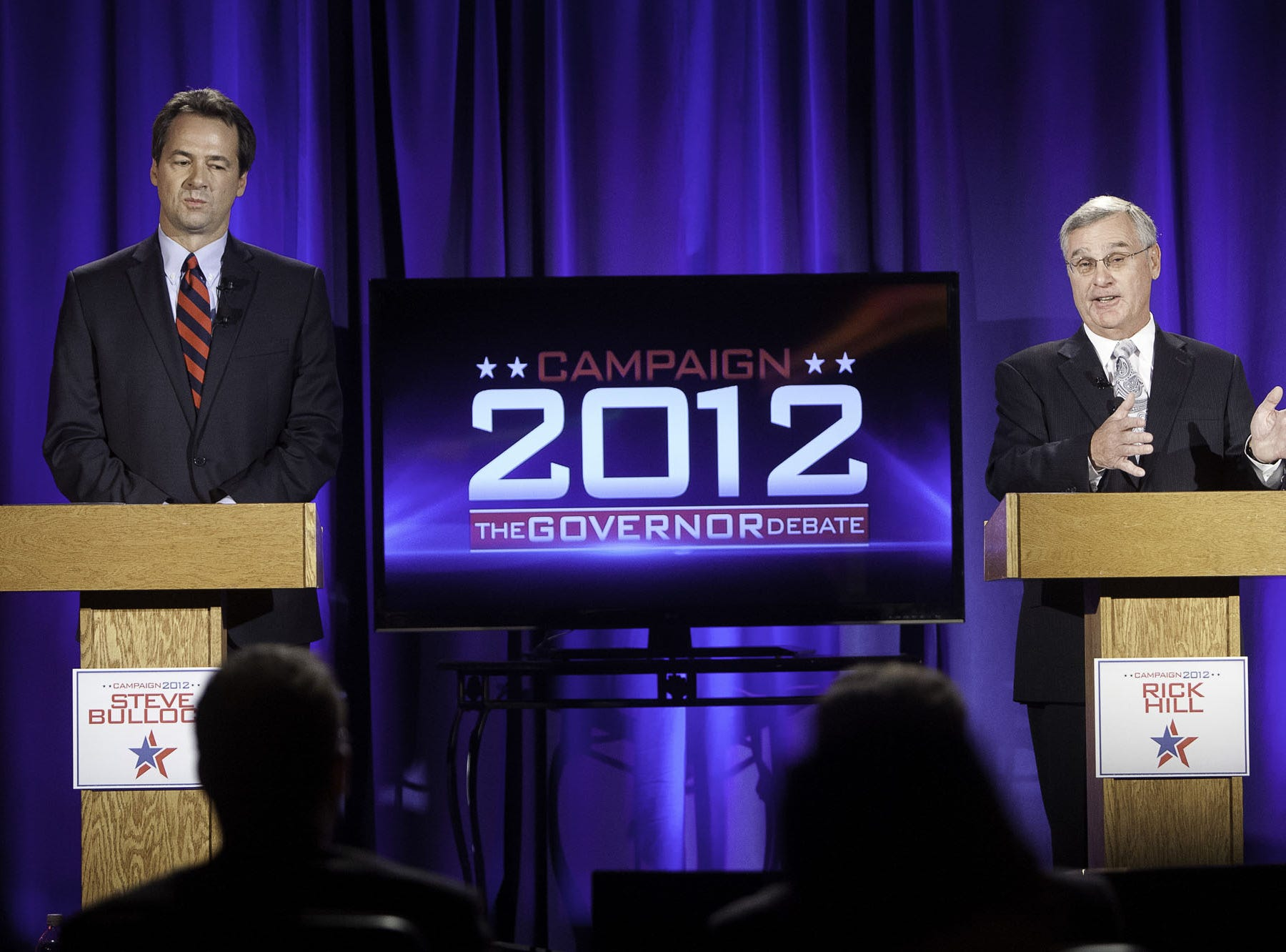 Democrat Steve Bullock, left, listens as Republican Rick Hill makes a point during their final televised gubernatorial debate at Riverside Country Club in Bozeman, Mont., Saturday, Oct. 27, 2012.  They are in a close race to succeed Democratic Gov. Brian Schweitzer. (AP Photo/Bozeman Daily Chronicle, Adrian Sanchez-Gonzalez)