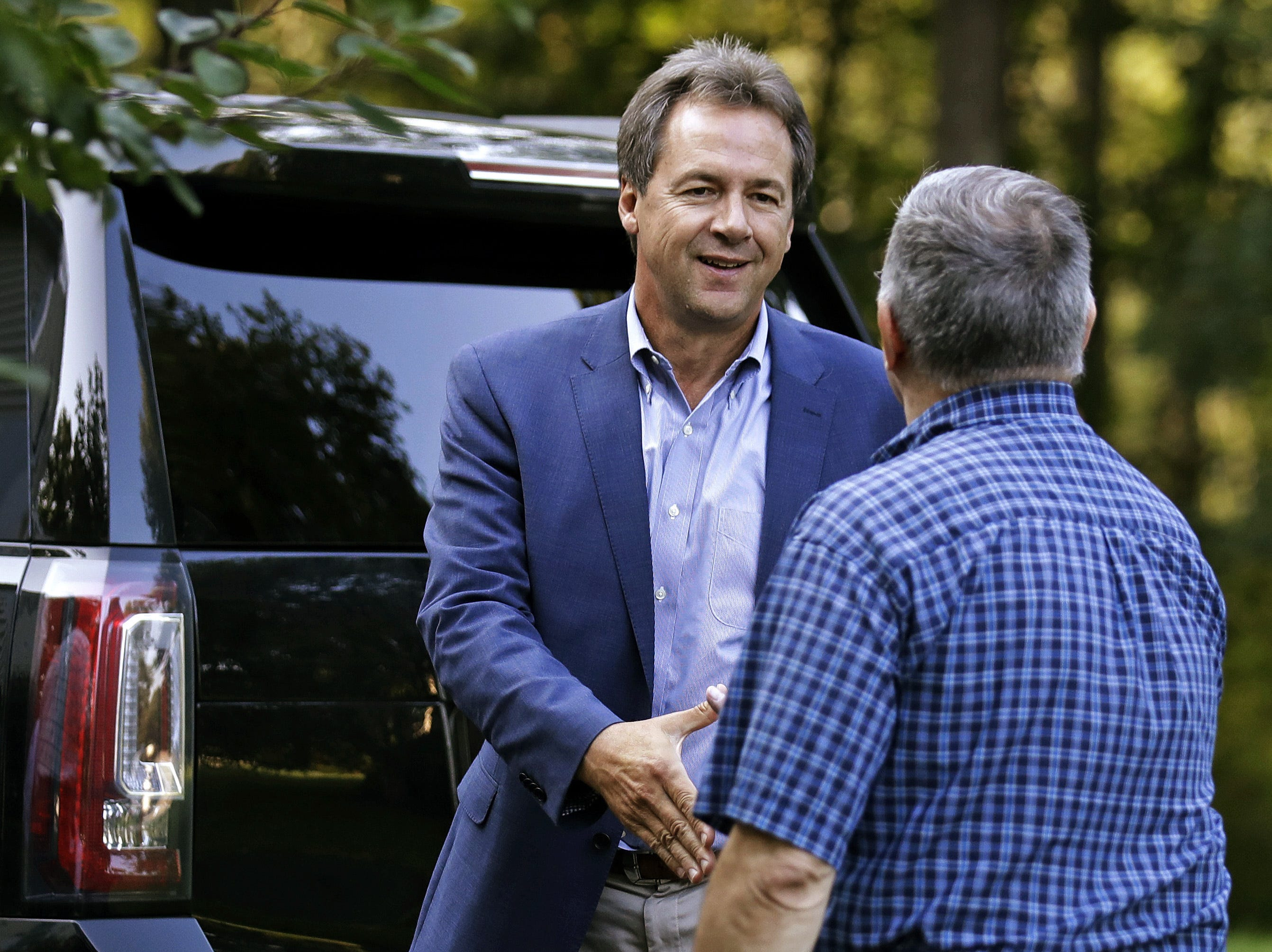 Gov. Steve Bullock, left, shakes hands with a guest as he arrives for a house party in Hampton, N.H., Friday.   Charles Krupa/AP Montana Gov. Steve Bullock, left, shakes hands with a guest as he arrives for a house party supporting Democratic candidates in Hampton, N.H., Friday, Aug. 24, 2018. Bullock is visiting New Hampshire this weekend as he explores a possible 2020 presidential bid. (AP Photo/Charles Krupa)