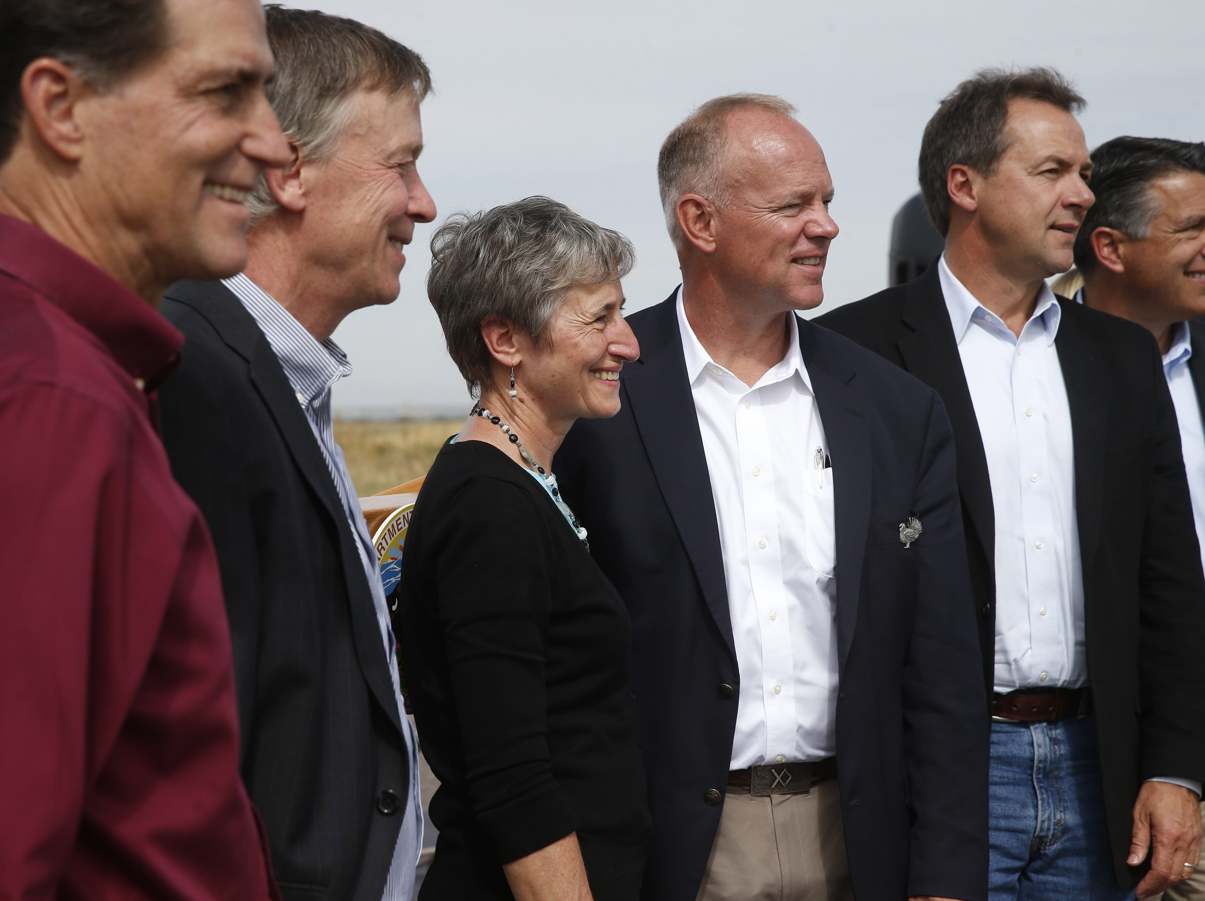 AP Photo/Brennan Linsley Interior Secretary Sally Jewell, third from left, poses for a group photo with, left to right, Dan Ashe, Director of the U.S. Fish and Wildlife Service, Colorado Gov. John Hickenlooper, Wyoming Gov. Matt Mead, Montana Gov. Steve Bullock, and Nevada Gov. Brian Sandoval, at a gathering where  Jewell made the formal announcement that the greater sage grouse does not need federal protections. Interior Secretary Sally Jewell, third from left, poses for a group photo with, left to right, Dan Ashe, Director of the U.S. Fish and Wildlife Service, Colorado Gov. John Hickenlooper, Wyoming Gov. Matt Mead, Montana Gov. Steve Bullock, and Nevada Gov. Brian Sandoval, at a gathering where Secretary Jewell made the formal announcement that the greater sage grouse, a ground-dwelling bird whose vast range spans 11 Western states, does not need federal protections, at Rocky Mountain Arsenal National Wildlife Refuge, in Commerce City, Colo., Tuesday Sept. 22, 2015. The Obama administration and affected states have committed hundreds of millions of dollars to saving the grouse without Endangered Species Act protections that many argued would threaten industry. (AP Photo/Brennan Linsley)