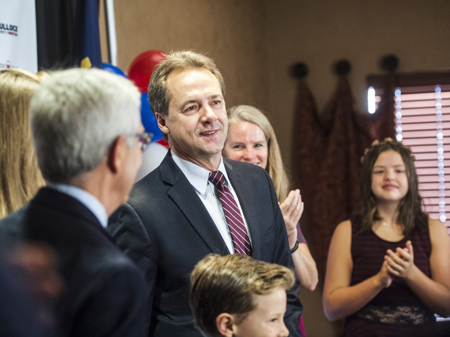 TRIBUNE PHOTO/JULIA MOSS Gov. Steve Bullock, center, talks with Lt. Gov. Mike Cooney on Wednesday while meeting with supporters and press at the Best Western Premier Helena Great Northern Hotel. Governor Bullock gives his acceptance speech to supporters and press at the Best Western Premier Helena Great Northern Hotel Wednesday morning.
