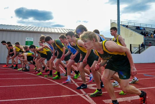 CMR's Gordon Gentry, right, and the rest of the 800m field line up on the starting line during the crosstown track meet between C.M. Russell High and Great Falls High on Tuesday at Memorial Stadium.