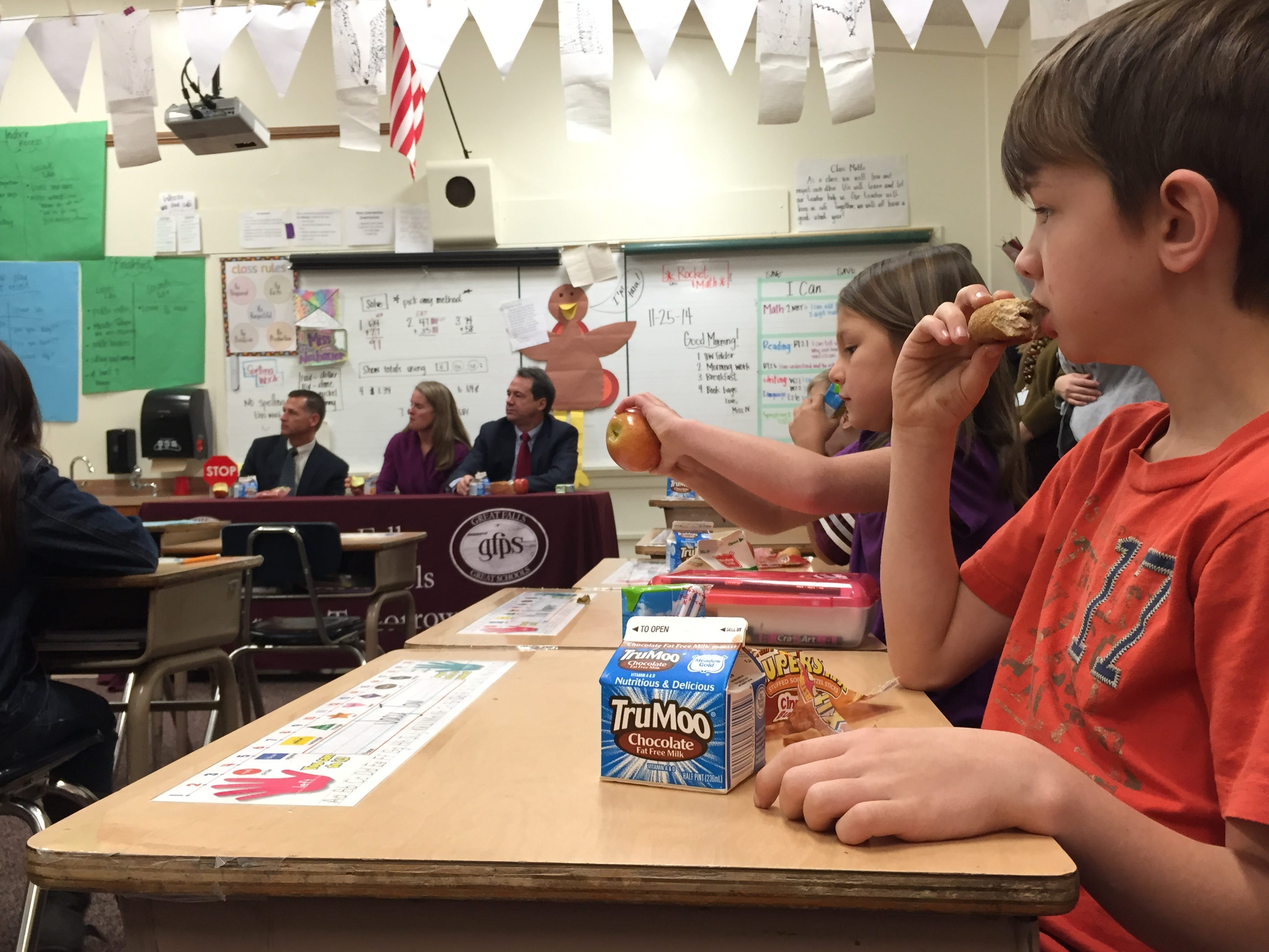TRIBUNE PHOTO/KRISTEN CATES Jacy Tow, a second-grader at West Elementary School, enjoys breakfast with Gov. Steve Bullock and first lady Lisa Bullock in his classroom Tuesday morning. Jacy Tow, a second-grader at West Elementary School, enjoys breakfast with Gov. Steve Bullock and First Lady Lisa Bullock in his classroom on Tuesday morning. TRIBUNE PHOTO/KRISTEN CATES.
