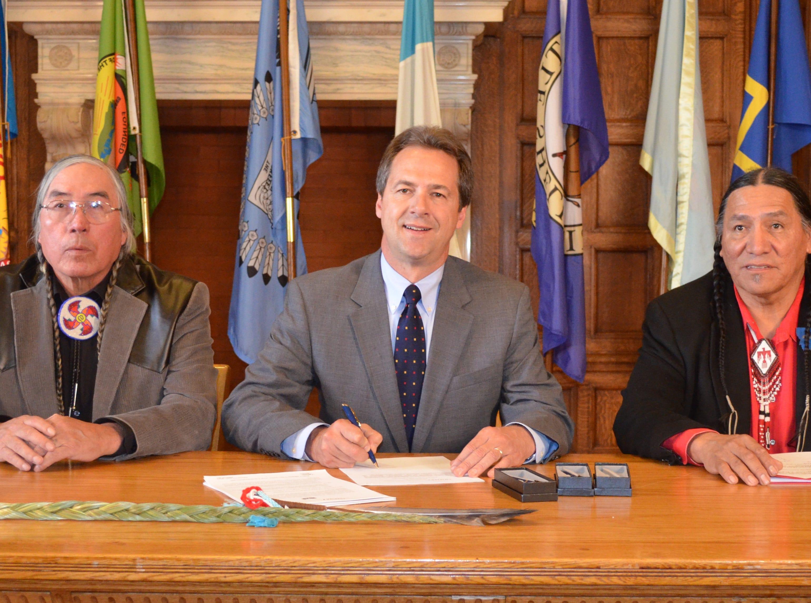 MONTANA STATE PHOTO Rep. George Kipp, D-Heart Butte, Gov. Steve Bullock and Sen. Jonathan Windy Boy, D-Box Elder, at the signing of Kipp and Windy Boy?s Indian language bills.
