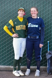 C.M. Russell High's Madi Moore, left, and Annie Toon of Great Falls High are pitching rivals and fast friends.