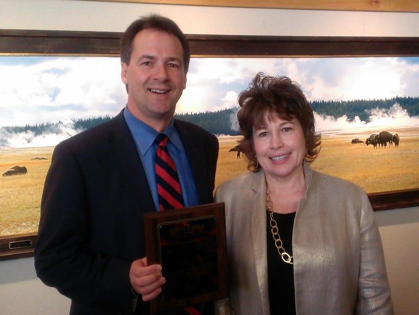 Gov. Steve Bullock presents Lorri Brenneman with the Mike Malone Educator of the Year award.   Courtesy photo Gov. Steve Bullock presents Lorri Brenneman  with the Mike Malone Educator of the Year award/