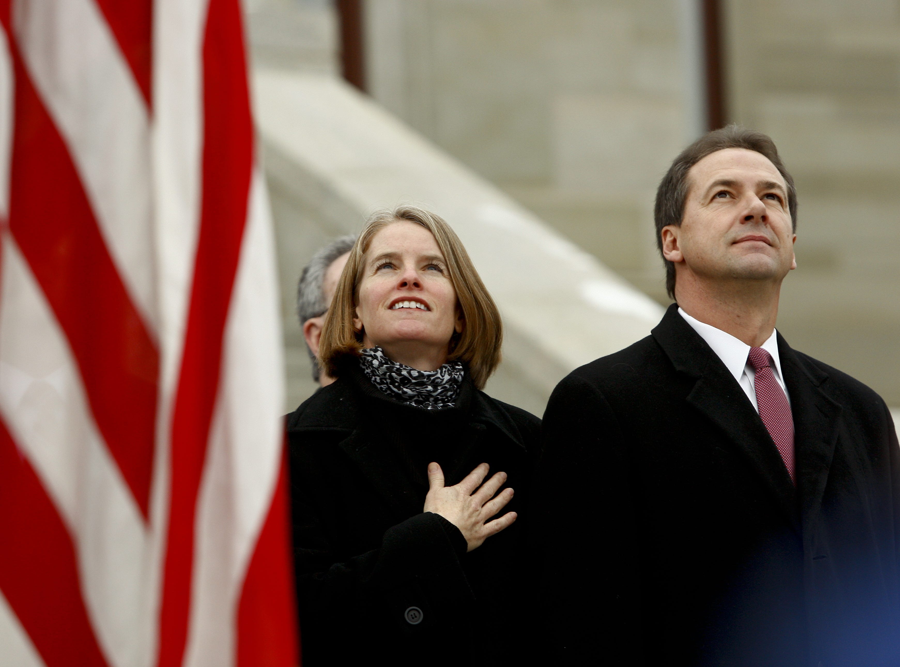 Steve and Lisa Bullock watch F-15s from the Montana Air National Guard fly over the Capitol Monday before Bullock is sworn in to office as Montana¿s 24th governor. TRIBUNE PHOTO/LARRY BECKNER Steve and Lisa Bullock watch F-15s from the Montana Air National Guard fly over the Capitol Monday before Bullock is sworn in to office as Montana's 24th governor on the steps of the Capitol.  TRIBUNE PHOTO/LARRY BECKNER