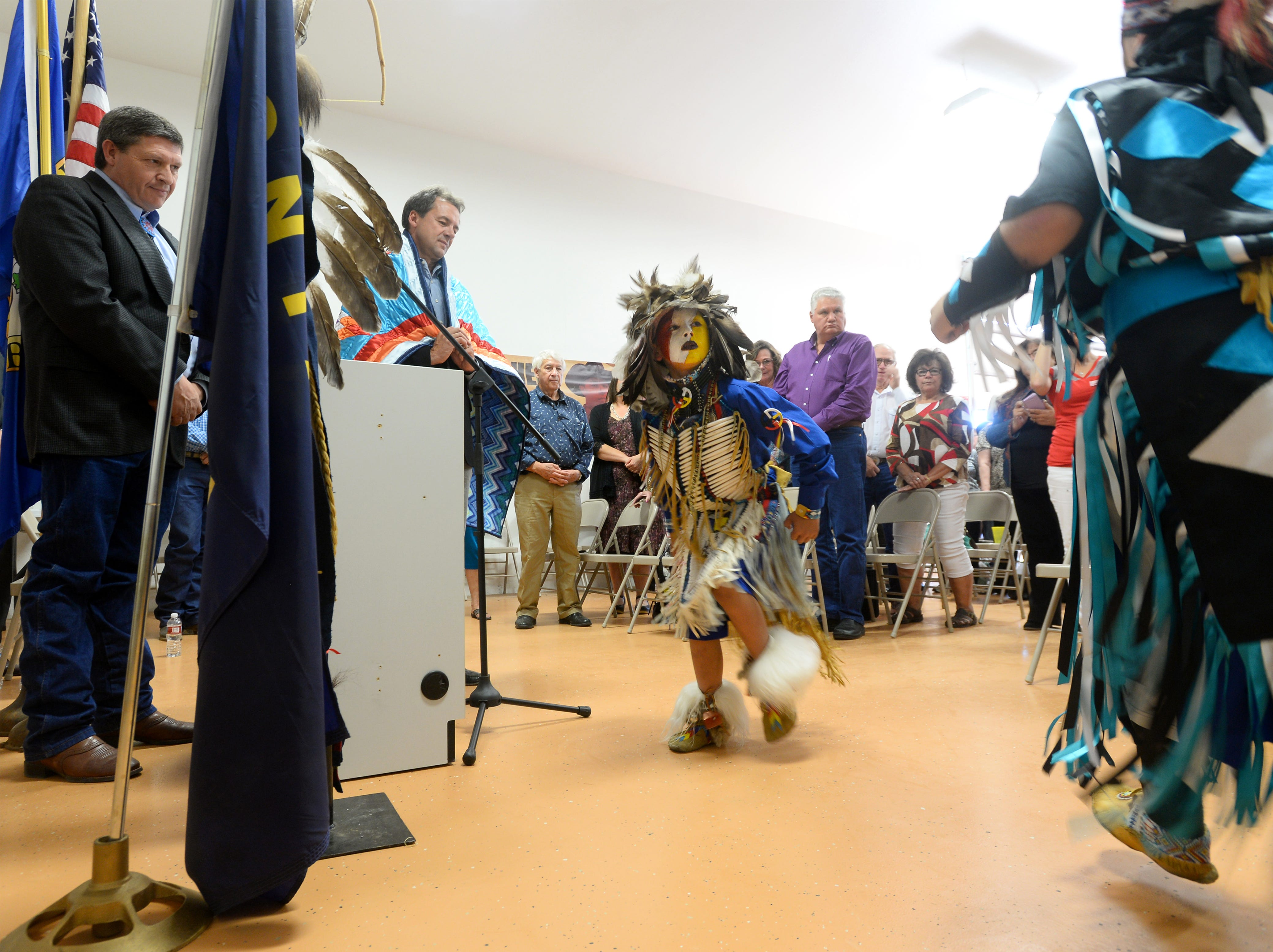 TRIBUNE PHOTO/RION SANDERS Cordiero, center, and Dametries Houle dance to an honor song for Gov. Bullock during the Little Shell Tribe?s recognition event on Thursday. Cordiero, center, and Dametries Houle dance to an honor song for Governor Steve Bullock during the Little Shell Tribe's recognition event on Thursday at the The Little Shell Cultural Center.  At the event Gov. Bullock recognized the Little Shell Tribe Language Program and grant recipients of the Indian Equity Fund.