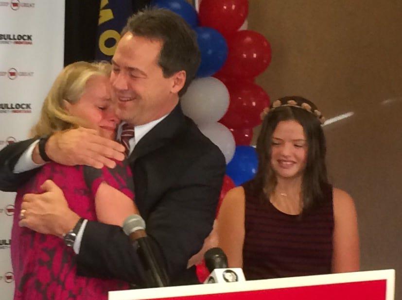 Tribune photo/Phil Drake Gov. Steve Bullock hugs wife, Lisa, on Nov. 9, after he was declared the winner in the race for governor.