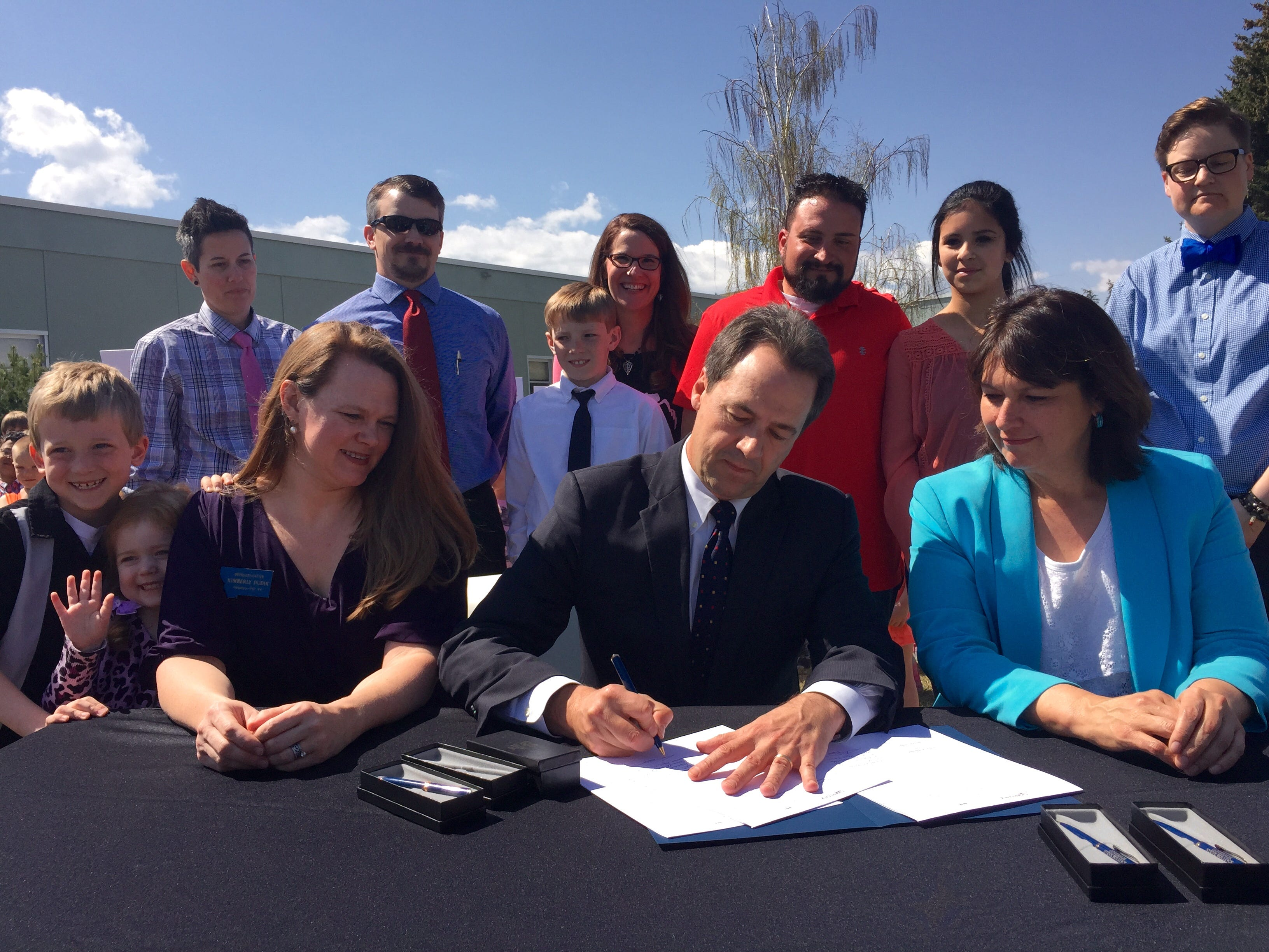 AP Montana Gov. Steve Bullock signs the Bully Free Montana Act Tuesday at Jefferson Elementary in Helena. Montana Gov. Steve Bullock signs the Bully Free Montana Act Tuesday, April 21, 2015 at Jefferson Elementary in Helena, Mont., while bill sponsor Rep. Kim Dudik, left, and Superintendent of Public Instruction Denise Juneau look on.  Lawmakers have been trying to pass some form of the measure since 2003 with opponents saying it would infringe on school districts' ability to enact local rules. Forty-six of the 49 states that have established bullying laws did so by 2010. (AP Photo/Lisa Baumann)