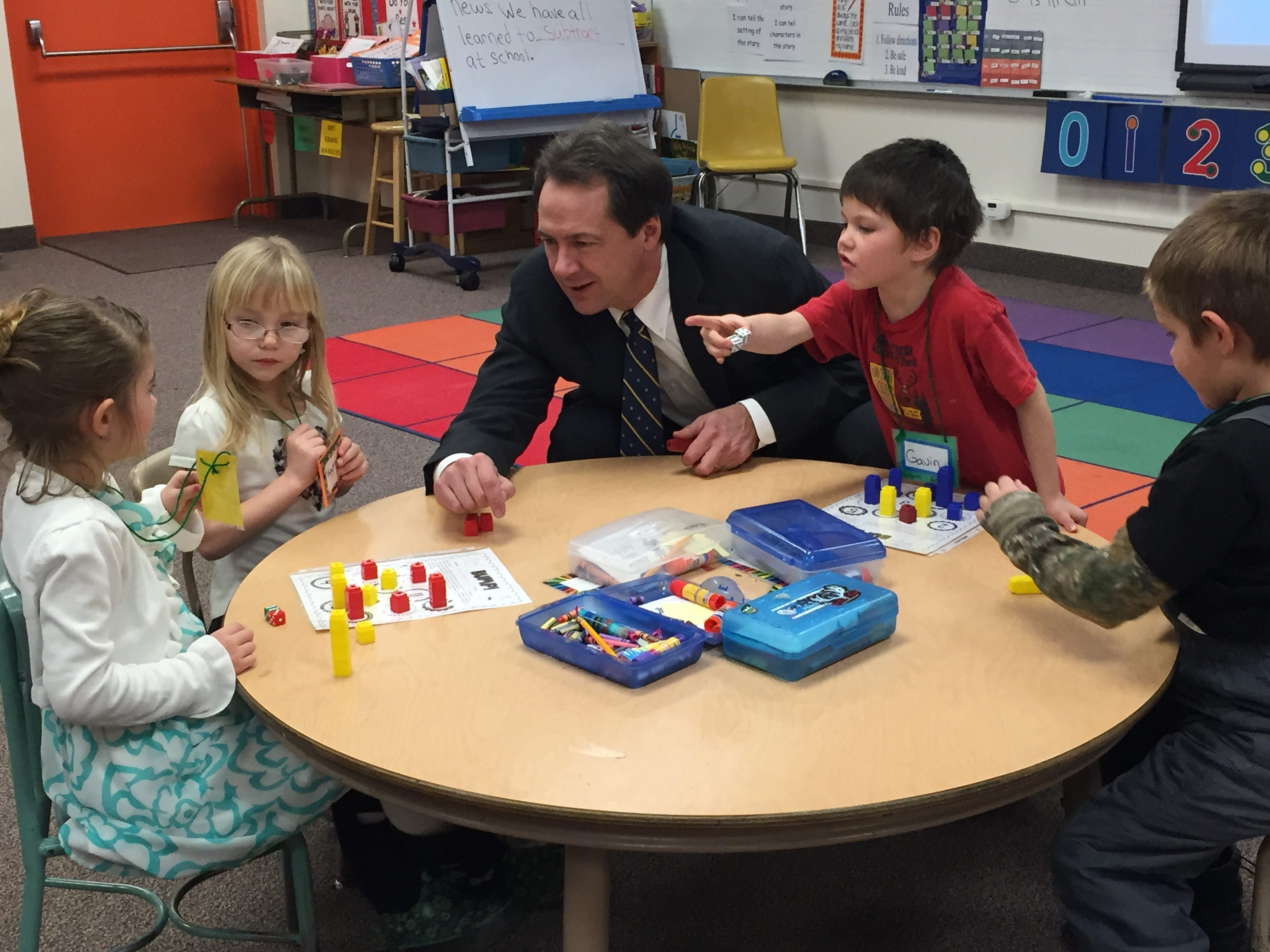 """TRIBUNE File PHOTO/KRISTEN CATES Gov. Steve Bullock plays a math game with kindergartners at West Elementary School in Great Falls in January. Gov. Steve Bullock plays """"Bump"""" - a math game - with kindergartners at West Elementary School in Great Falls on Wednesday. TRIBUNE PHOTO/KRISTEN CATES."""
