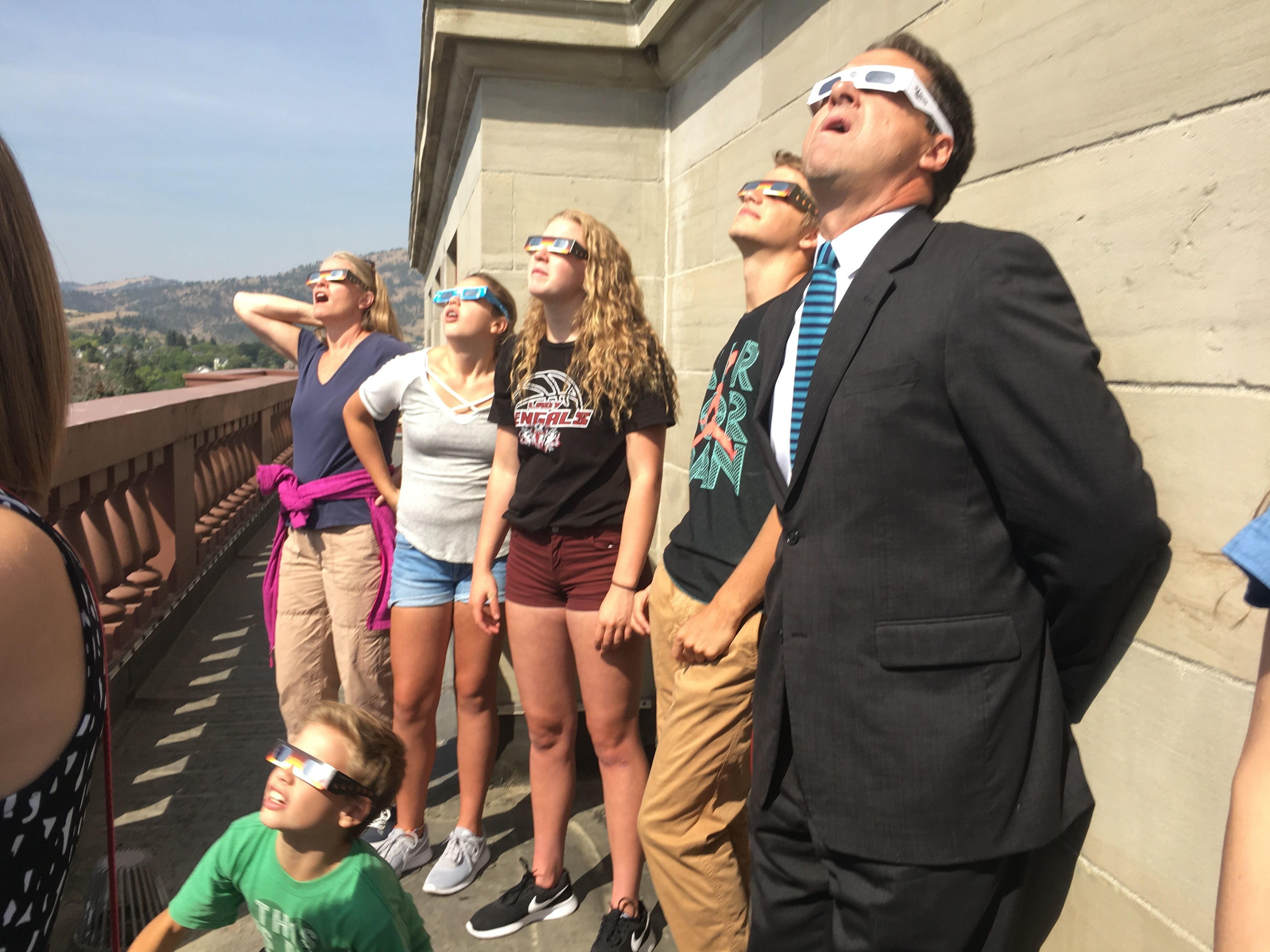 Governor Steve Bullock watches the solar eclipse with his family and others from the dome of the state Capitol building.  Marissa Perry Governor Steve Bullock watches the solar eclipse with his family and others from the dome of the state capitol building on Monday.