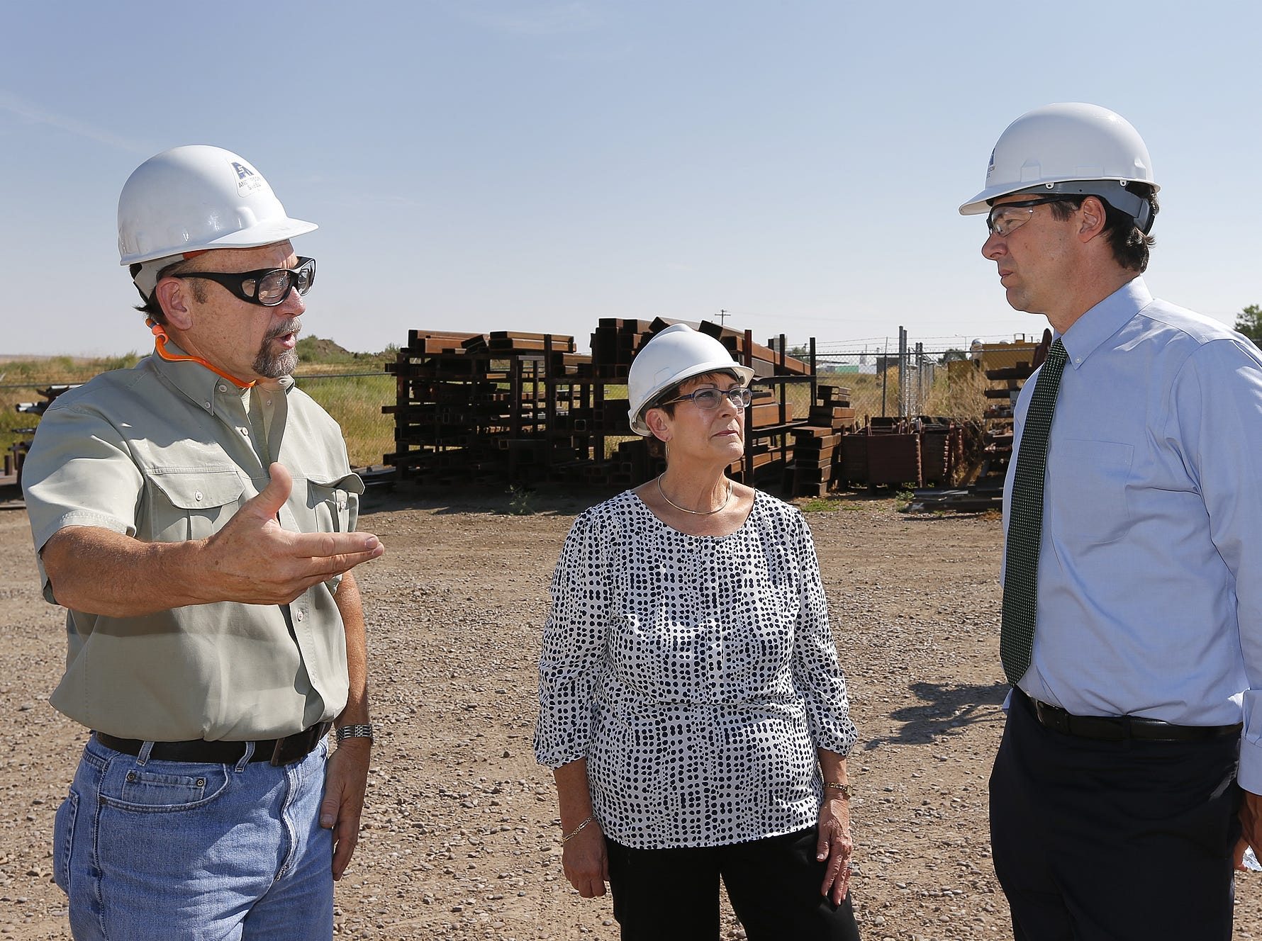 TRIBUNE PHOTO/LARRY BECKNER Steve Patrick, vice president of operations, left, and Susan Humble, president and CEO of Anderson Steel, talk with Gov. Steve Bullock during a tour of Anderson Steel on Tuesday. Steve Patrick, vice president of operations, left, and Susan Humble, president and CEO of Anderson Steel, talk with Gov. Steve Bullock during a tour of Anderson Steel Tuesday.