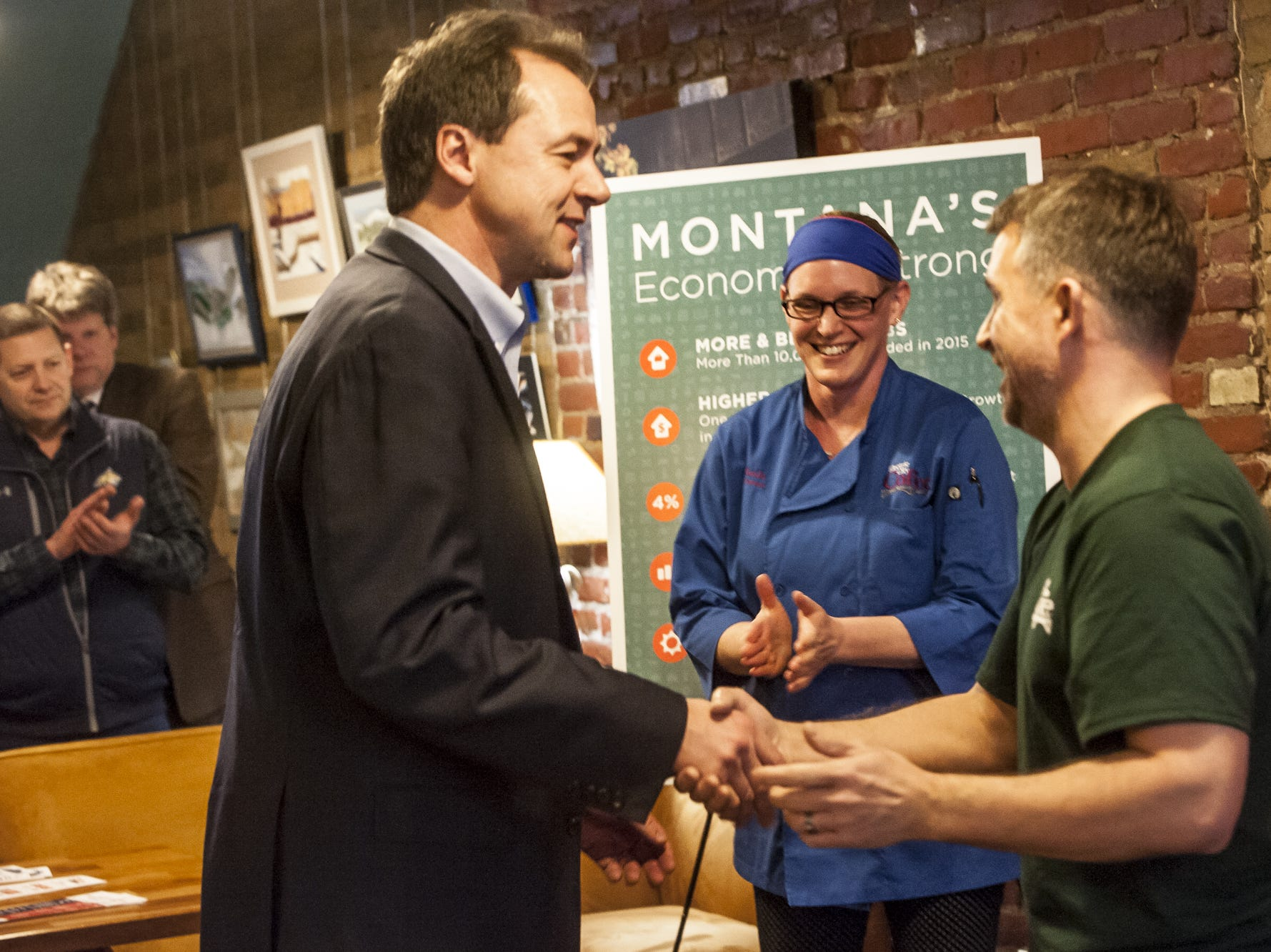 Governor Steve Bullock greets Electric City Coffee owners Thad and Heide Reiste during a brief celebration of Montana's small business success before First Friday events March 4, 2016.