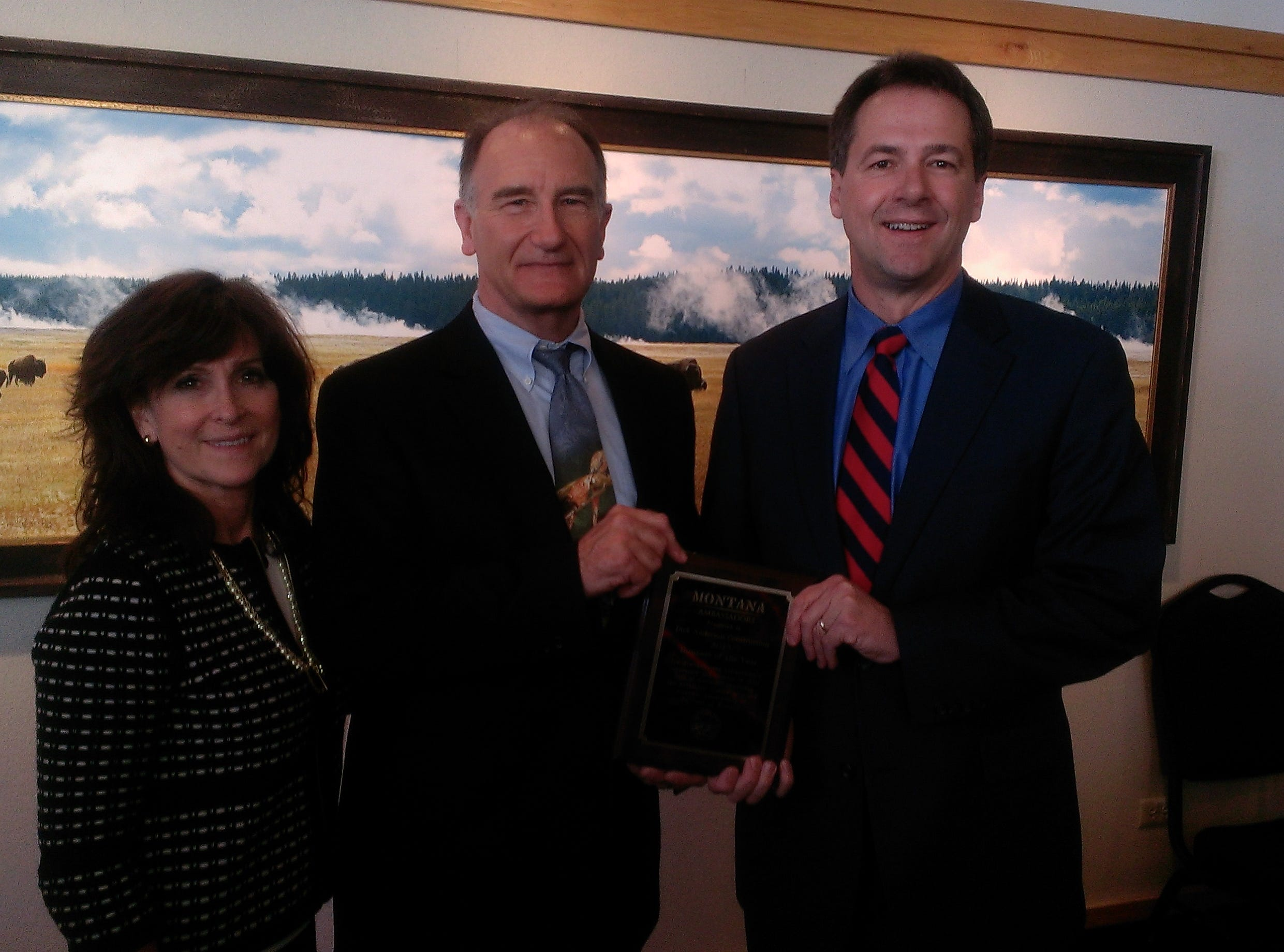 Dick Anderson Construction was presented the 2013 Montana Ambassador Business of the Year Award for demonstrating innovation and success in the industry, and improving the workforce, communities and economic development of the state. From left, Margaret Anderson, Dick Anderson and Gov. Steve Bullock. courtesy photo