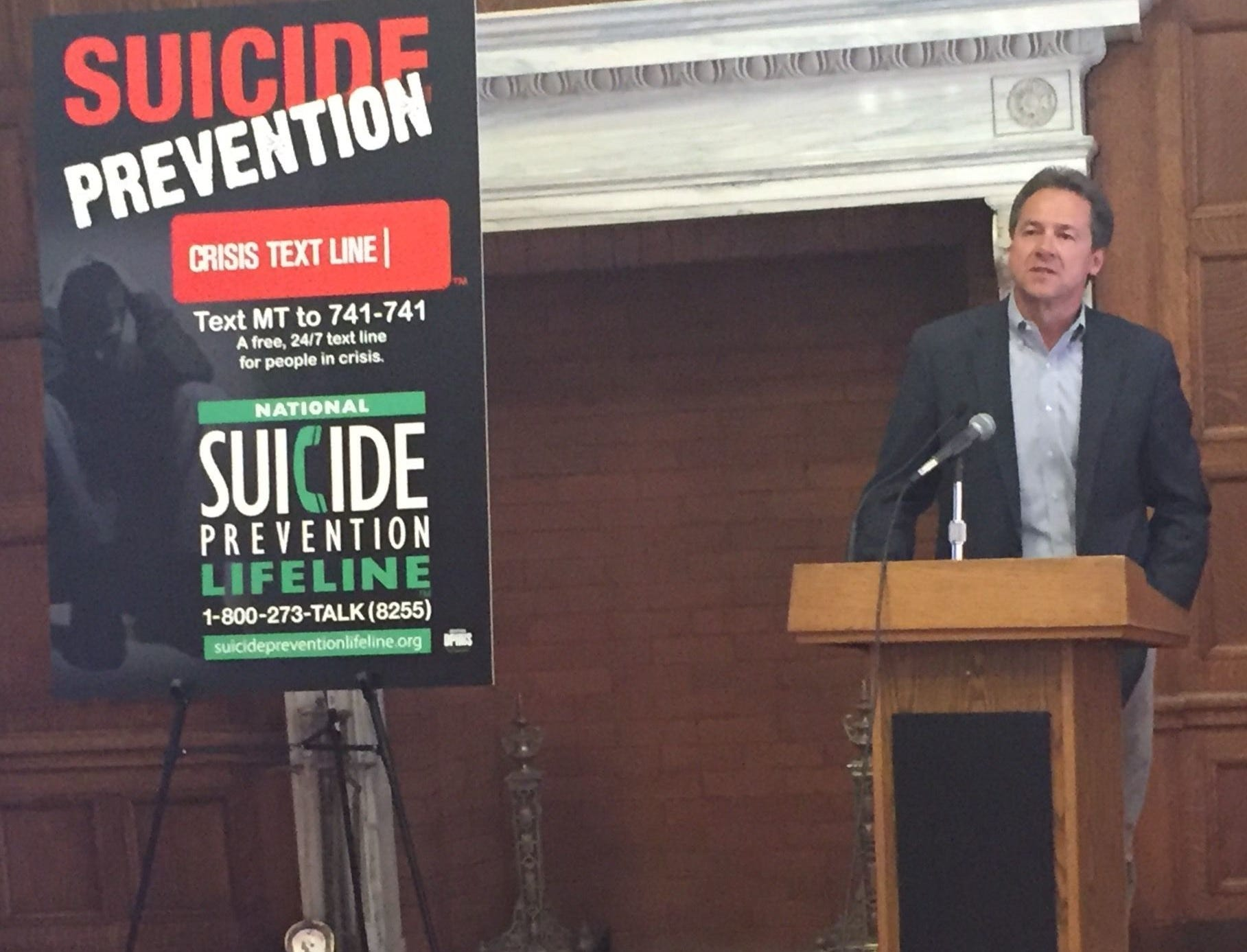 Tribune photo/Phil Drake Gov. Steve Bullock helps unveil a media campaign on Wednesday to raise awareness about suicide in Montana. Gov. Steve Bullock helps unveil a media campaign on Wednesday to raise awareness about suicide in Montana.