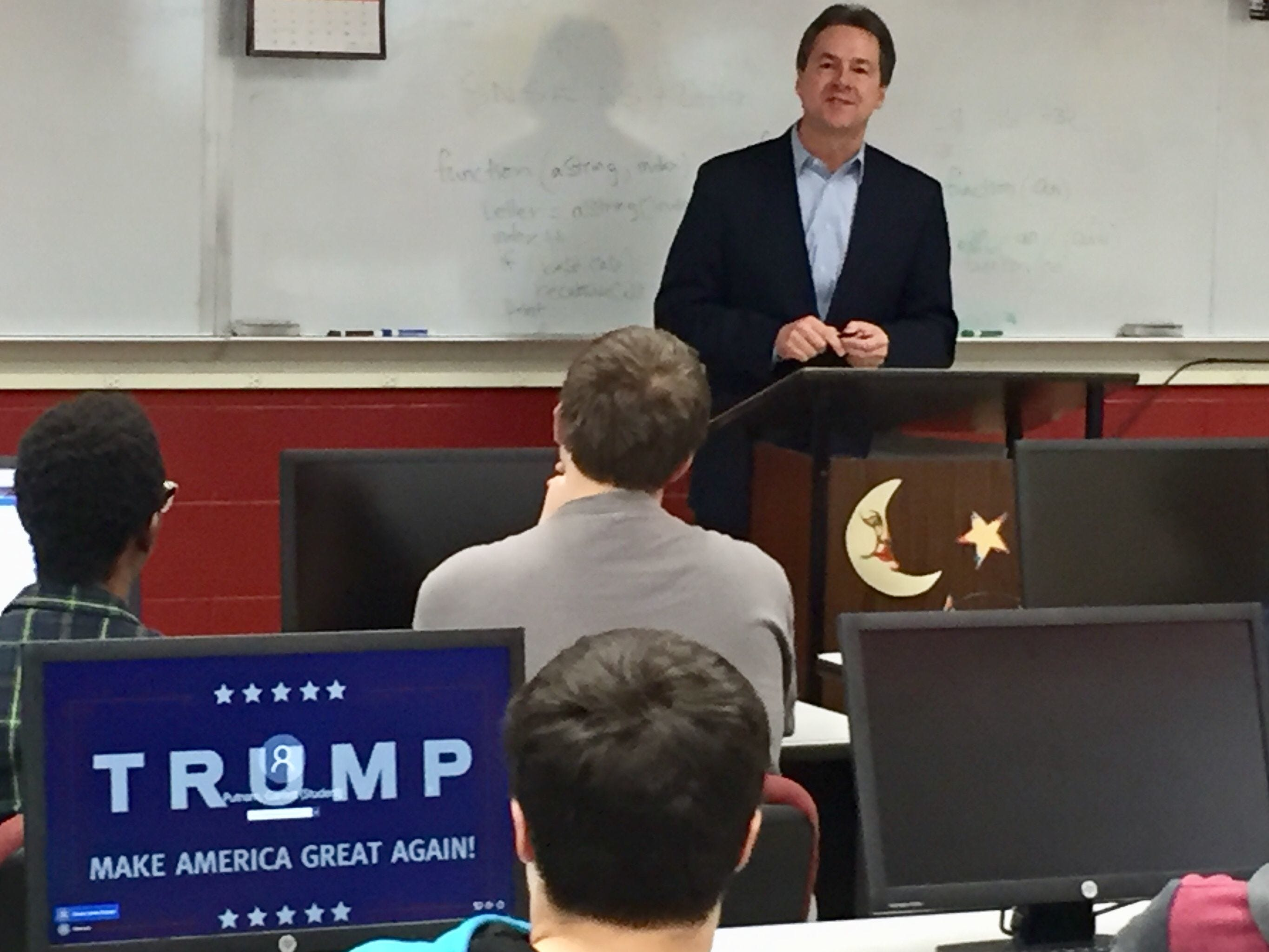 Democratic Gov. Steve Bullock announces internet neutrality policy Monday at Helena High. State contractors will be required to abide by principles of an open internet.  Tribune photo/Phil Drake Democratic Gov. Steve Bullock announces internet neutrality policy Monday at Helena High. (Student at desk says Trump screensaver not his)..