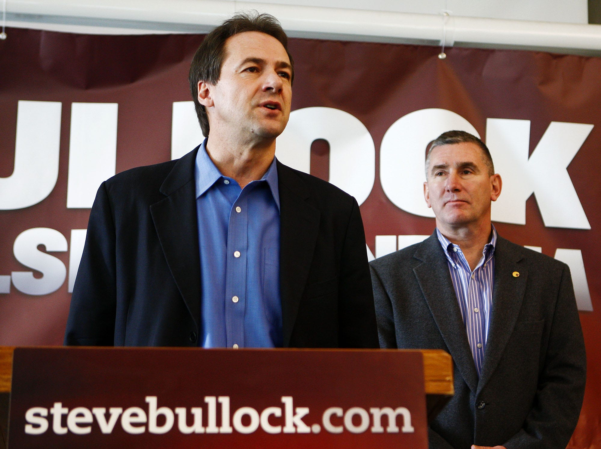 Steve Bullock, who is running for governor of Montana, left, announces his running mate, Brigadier General John Walsh (ret.) as lieutenant governor Thursday at the Great Falls International Airport. TRIBUNE PHOTO/LARRY BECKNER