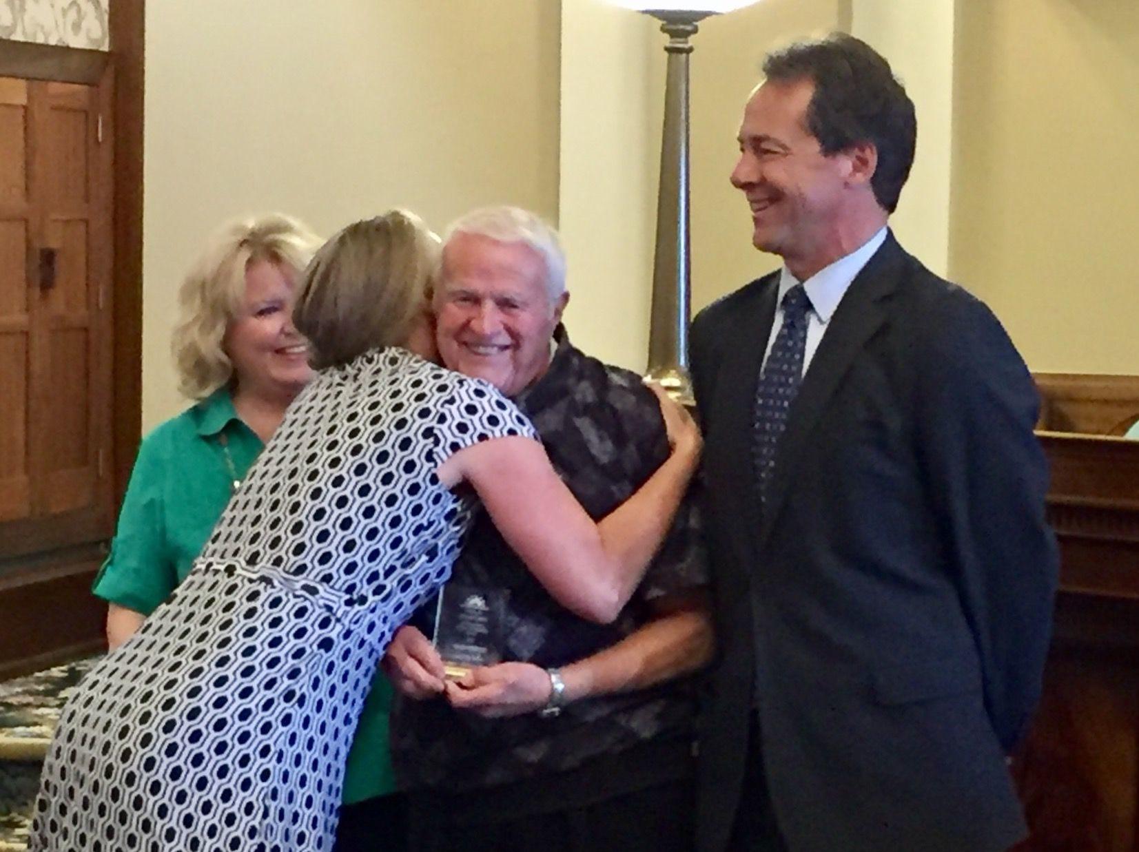 Tribune photo/Phil Drake First Lady Lisa Bullock hugs Harold Spilde on Friday as Gov. Steve Bullock looks on. First lady Lisa Bullock hugs Harold Spilde on Friday as Gov. Steve Bullock looks on.
