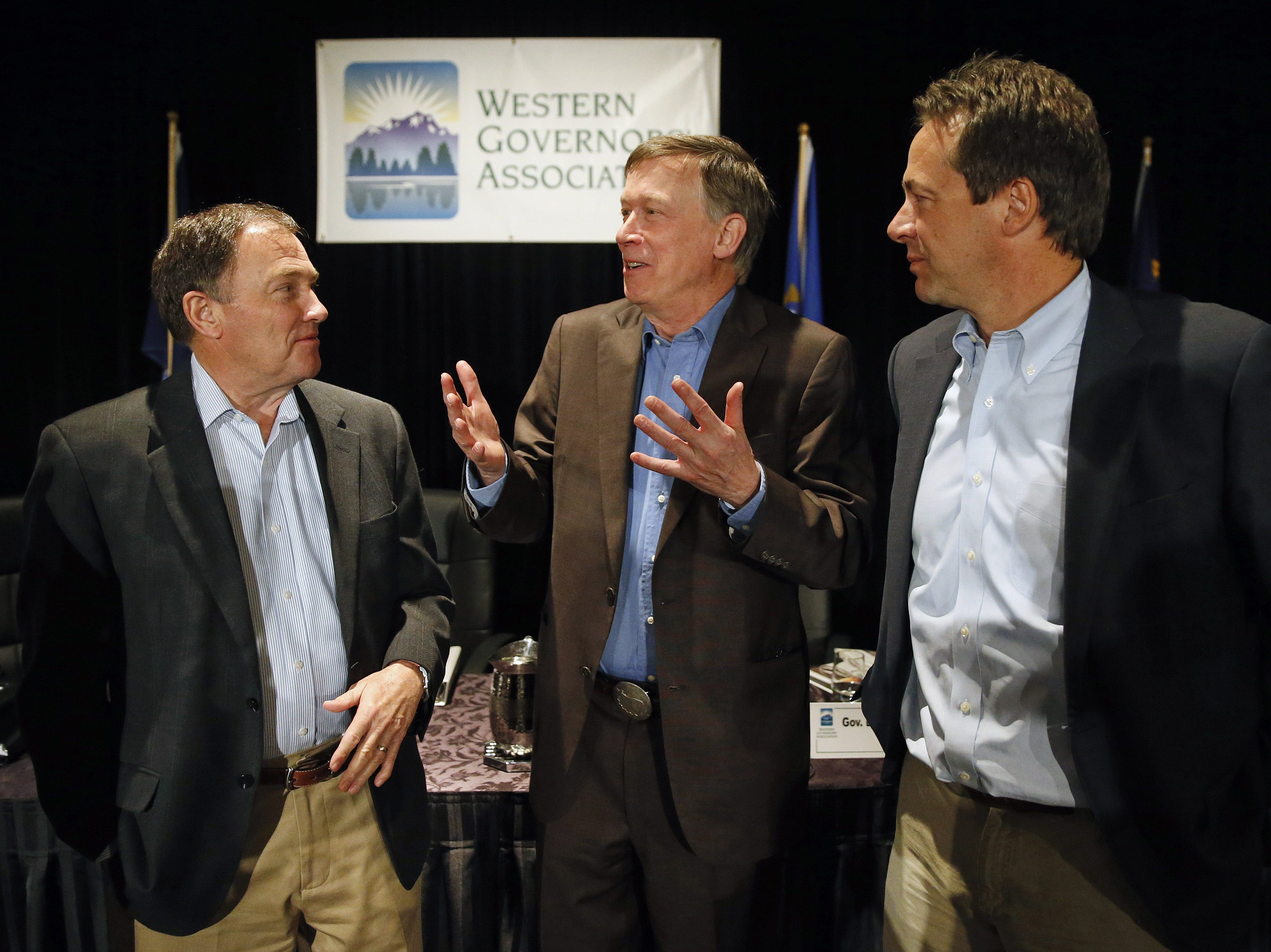 AP Photo/Brennan Linsley Colo. Gov. John Hickenlooper, center, talks with fellow Govs. Gary Herbert of Utah, left, and Montana?s Steve Bullock in Colorado Springs on June 10, 2014. Colo. Gov. John Hickenlooper, center, talks with fellow Governors Gary Herbert of Utah, left, and Montana's Steve Bullock, during the annual Western Governors' Association Meeting, at the Broadmoor Hotel in Colorado Springs, Tuesday, June 10, 2014. Ten governors from western states attended the second day of the conference Tuesday, discussing common regional issues. (AP Photo/Brennan Linsley)