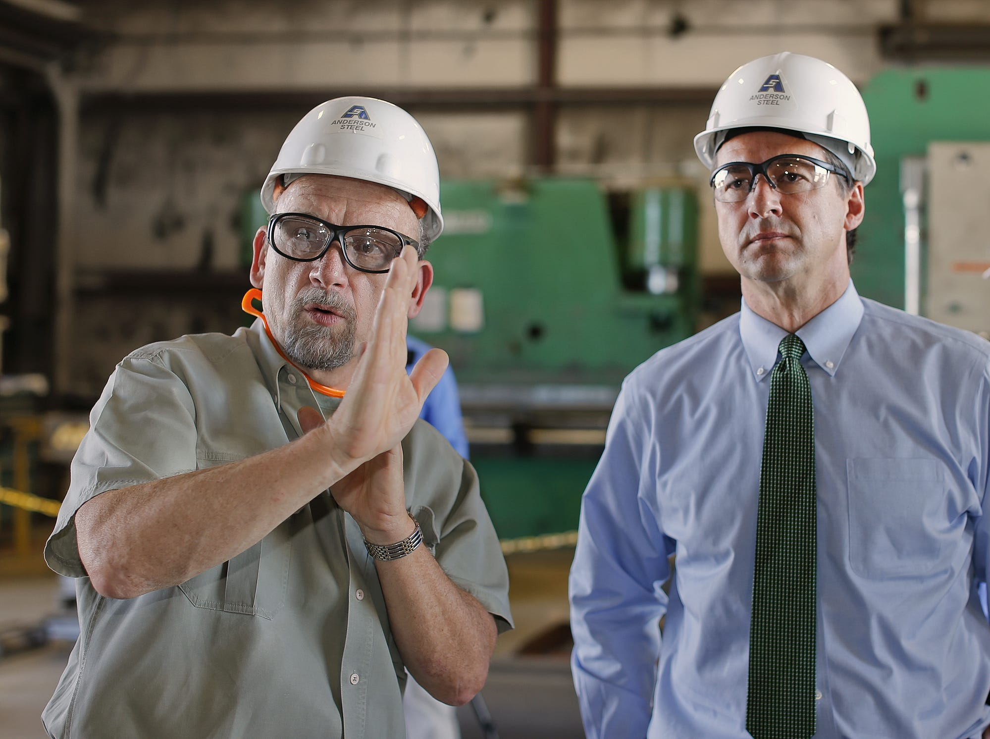 Steve Patrick operations manager of Anderson Steel, left, explains what the Great Falls based company does to Gov. Steve Bullock during a tour Tuesday.