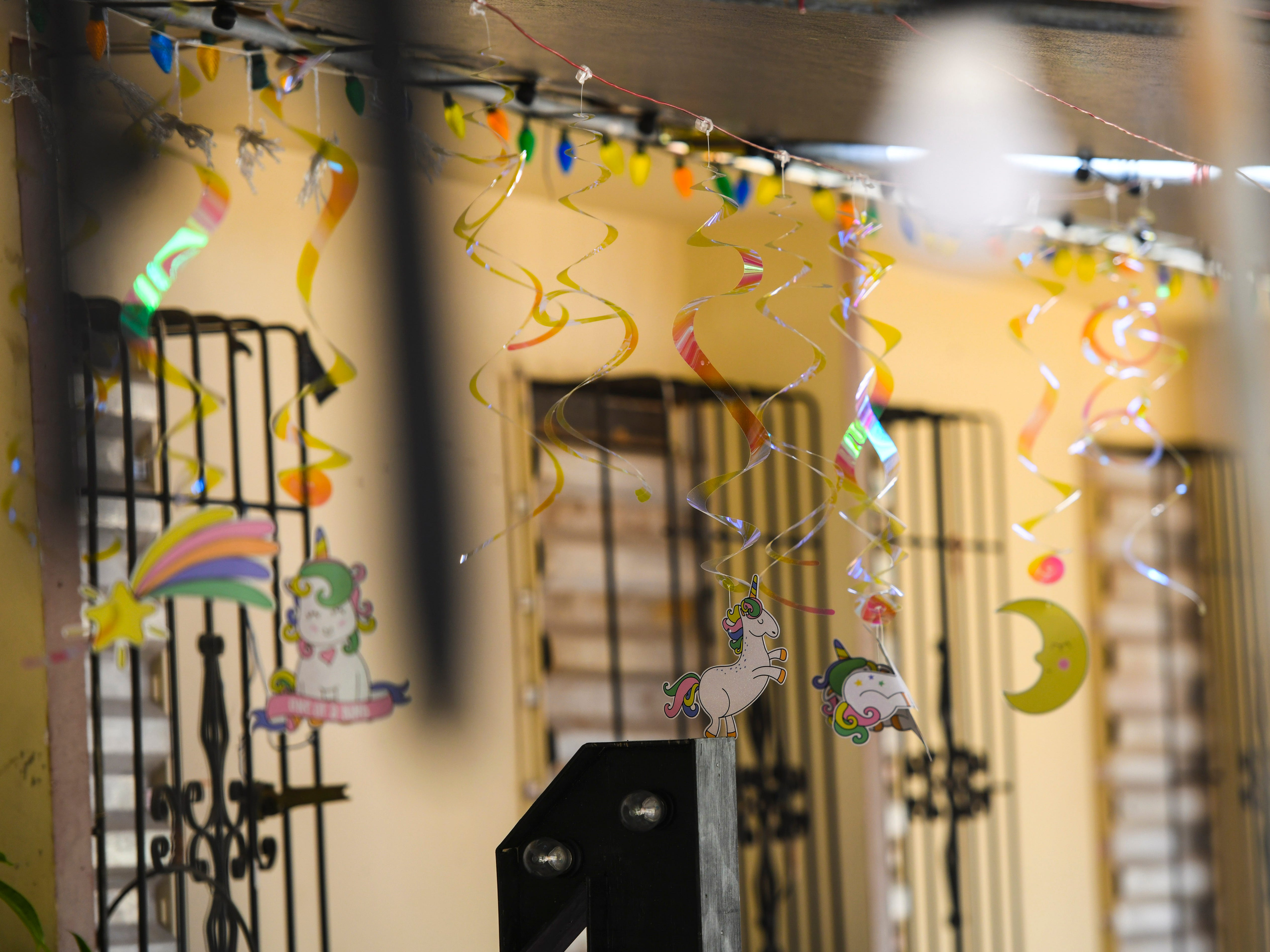 Decorations hang under the canopy of the David residence in preparation of celebrating a birthday on May 8, 2019. The occasion was tarnished, when tradegy struck the night before, when four-year-old Jericho Zion David died in his father's arms after being struck by a motorist driving in front of the family's residence.