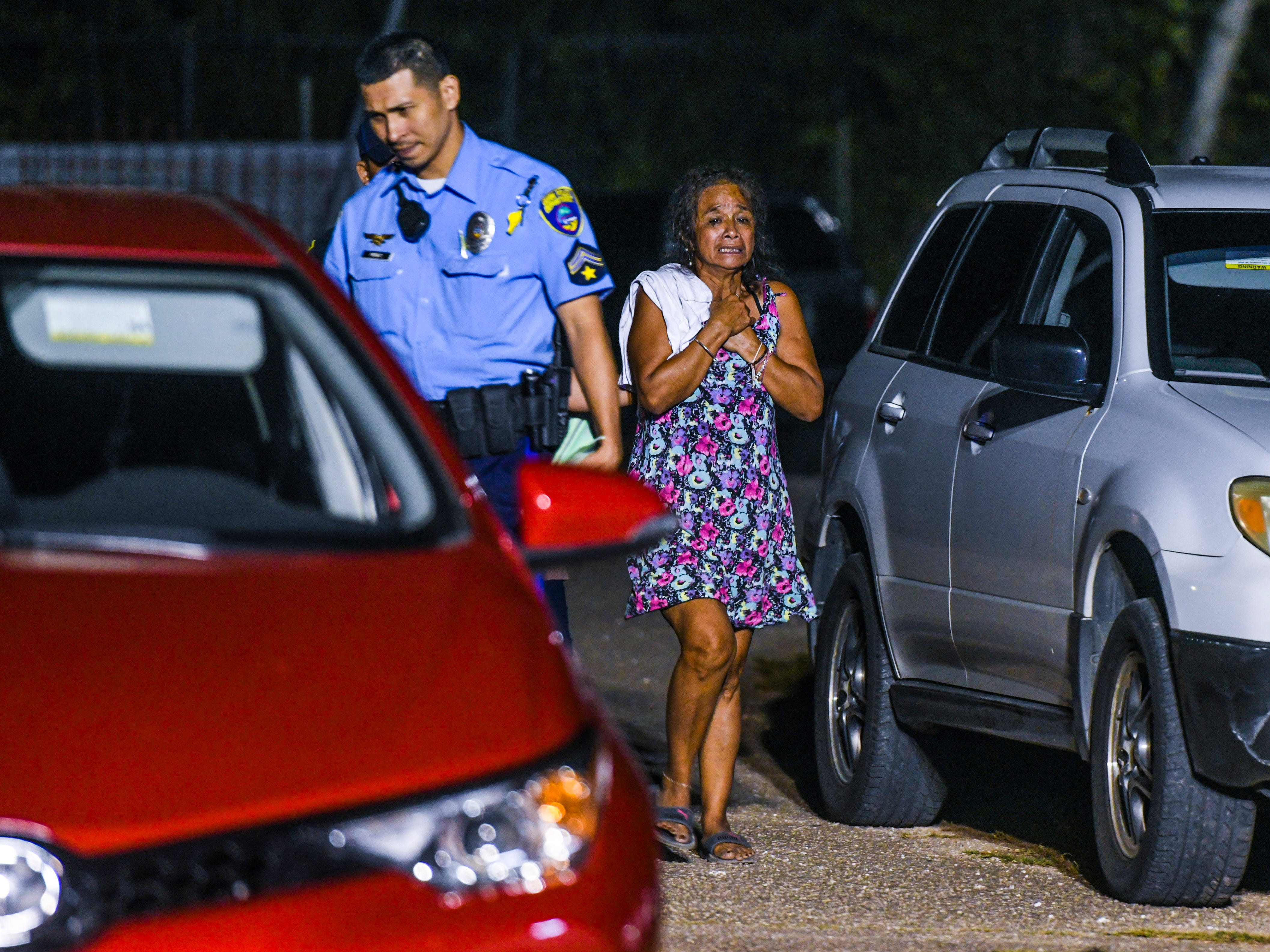 Emotions overcome Rose David as Guam Police Department officers conduct an investigation of a fatal auto-pedestrian incident in front of her Dededo home on the evening of Wednesday, May 7, 2019. David's four-year-old grandson, Jericho Zion David, died after being struck by a motorist driving in front of the family's home.
