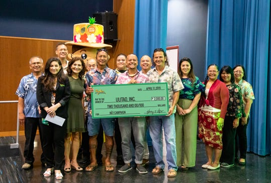 "Pay-Less Markets, Inc. presented a check of $2,000 to Ulitao, Inc., the beneficiary for Pay-Less Markets second annual ""Na'i Campaign"" Throughout the month of March, a portion of all ""Made on Guam"" products sold at Pay-Less Supermarkets were donated towards Ulitao, Inc., a nonprofit seafaring organization. They are a passionate group of Guam islanders working to revive, preserve, and grow the CHamoru's ancient seafaring traditions. From left: Hector Deleon, Katarina Sgro, Eloy Lizama, Kathy Calvo, Bob Field, Ron Acfalle, Ulitao founder; Kaylin Cruz, Mike Maguadog, Ulitao vice president; Mike Benito, Jeff Quitugua, Ulitao president; Alyssa Benito, Stacey Quitugua, Alma Guiang and Doris De Guzman."