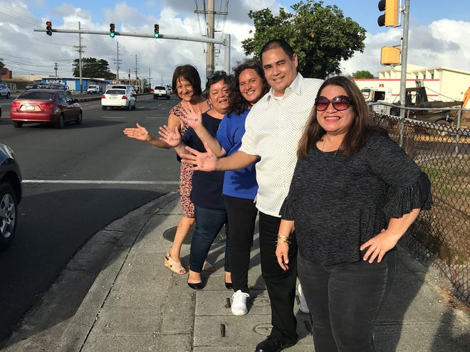"""Contractors License Board employees under the leadership of Cecil """"Buddy"""" Orsini supported the protest shouting out """"Enough is Enough!"""" (alongside are CLB staff Lily Santos, Jan Shimizu, Vince Aguon, Chris Leon Guerrero and DPW private secretary Lisa Villagomez on April 24."""