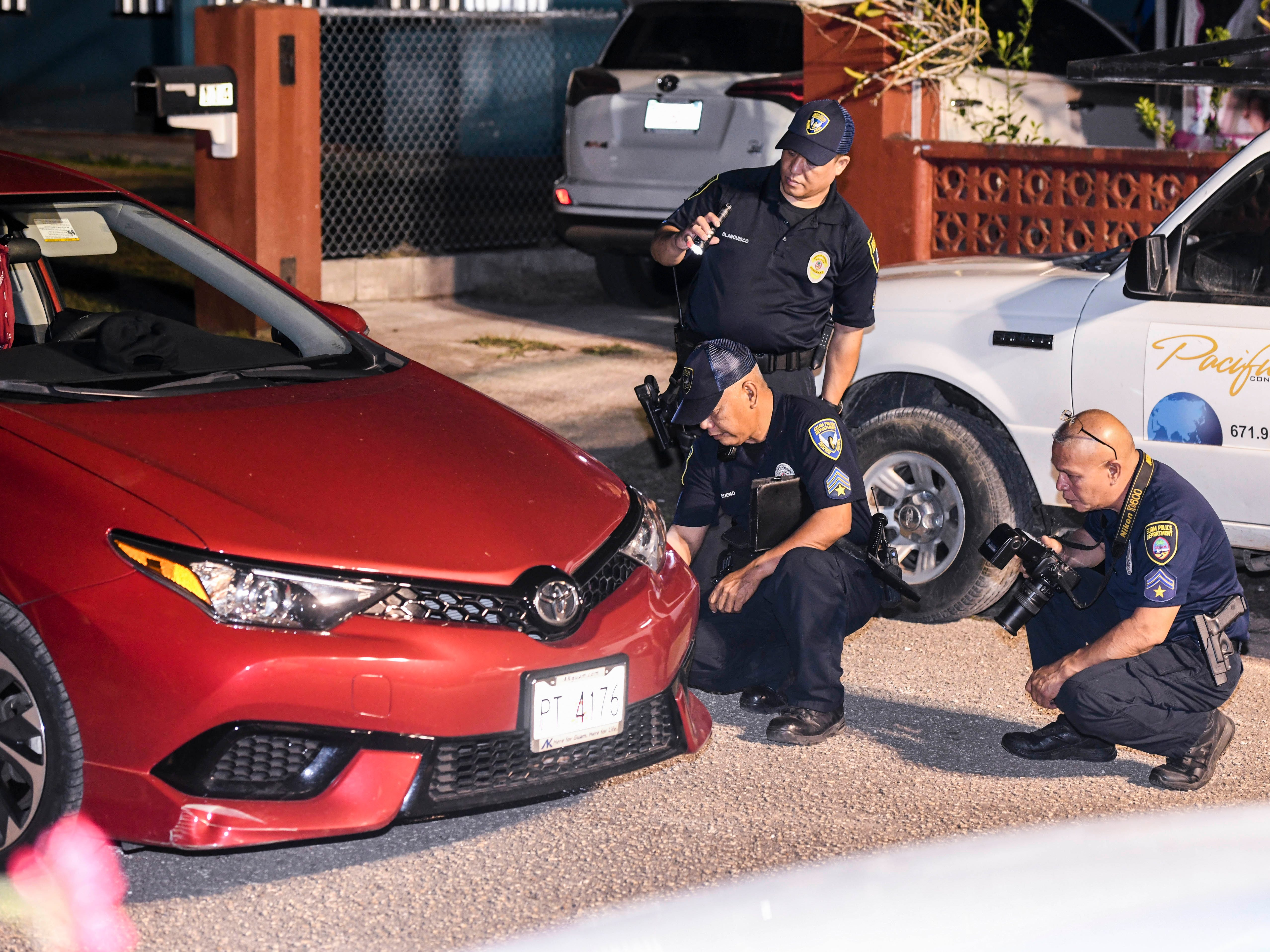 Officers from the Guam Police Department conduct an investigation of a fatal auto-pedestrian incident in Dededo on the evening of Wednesday, May 7, 2019. Four-year-old Jericho Zion David died, after being struck in front of his family's home, by a driver operating a Red Toyota Corolla.