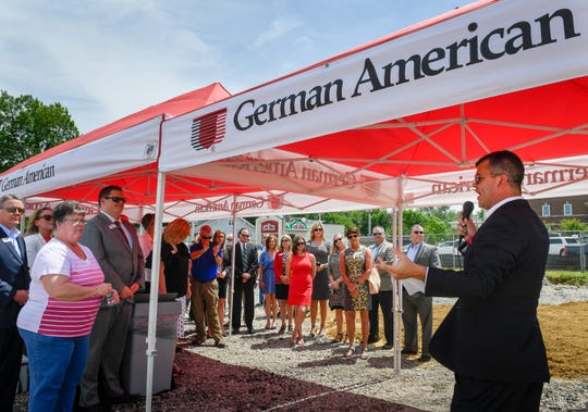 Doug Bell, Henderson resident and vice president of commercial banking, speaks to guests attending the groundbreaking for a new German American branch bank in Henderson at the corner of Green and Center streets Wednesday.