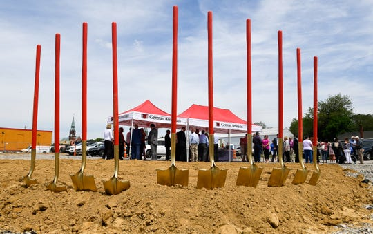 As a crowd gathers, ceremonial shovels stand at the ready Wednesday for the groundbreaking of a new German American Bank branch to be located at the corner of Green and Center streets in Henderson.
