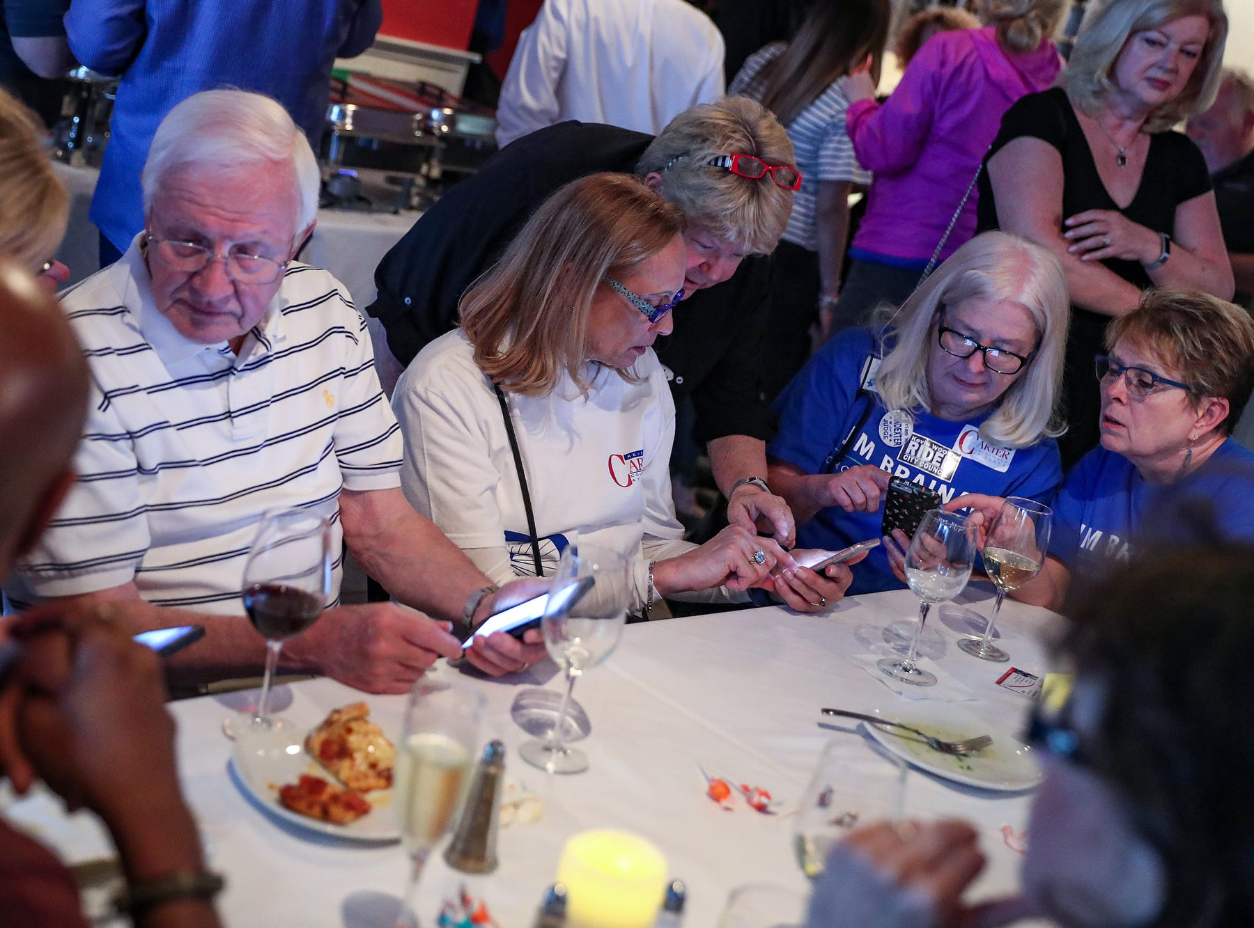 Supporters and friends watch their phones while awaiting election results for Carmel Republican candidates at DonatelloÕs Italian Restaurant in Carmel, Ind., Tuesday, May 7, 2019.