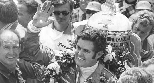 Al Unser waves to the crowd after winning his second consecutive 500.