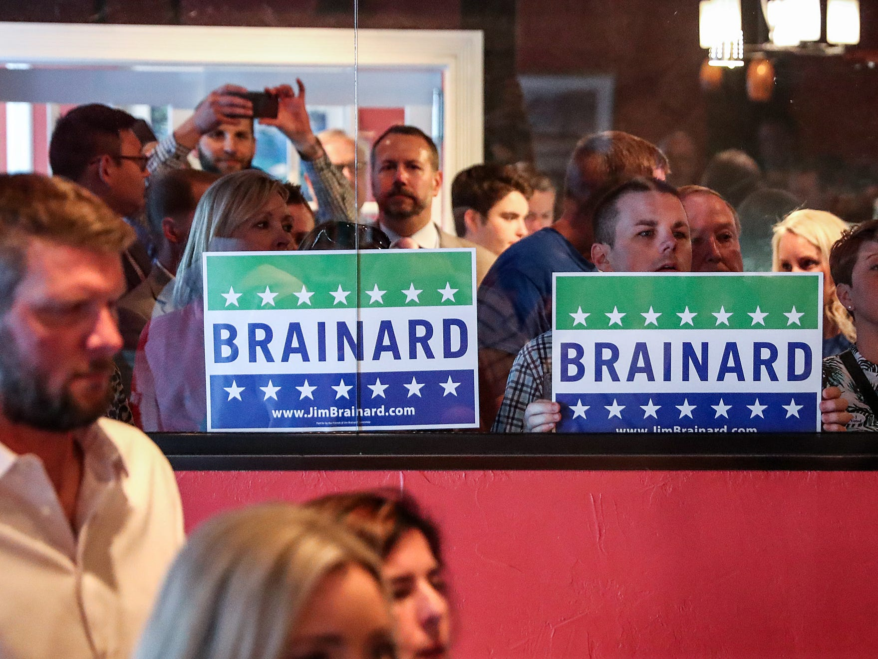 Supporters and friends hold signs for Carmel Mayor Jim Brainard at an election watch party for Carmel Republican candidates at DonatelloÕs Italian Restaurant in Carmel, Ind., Tuesday, May 7, 2019.