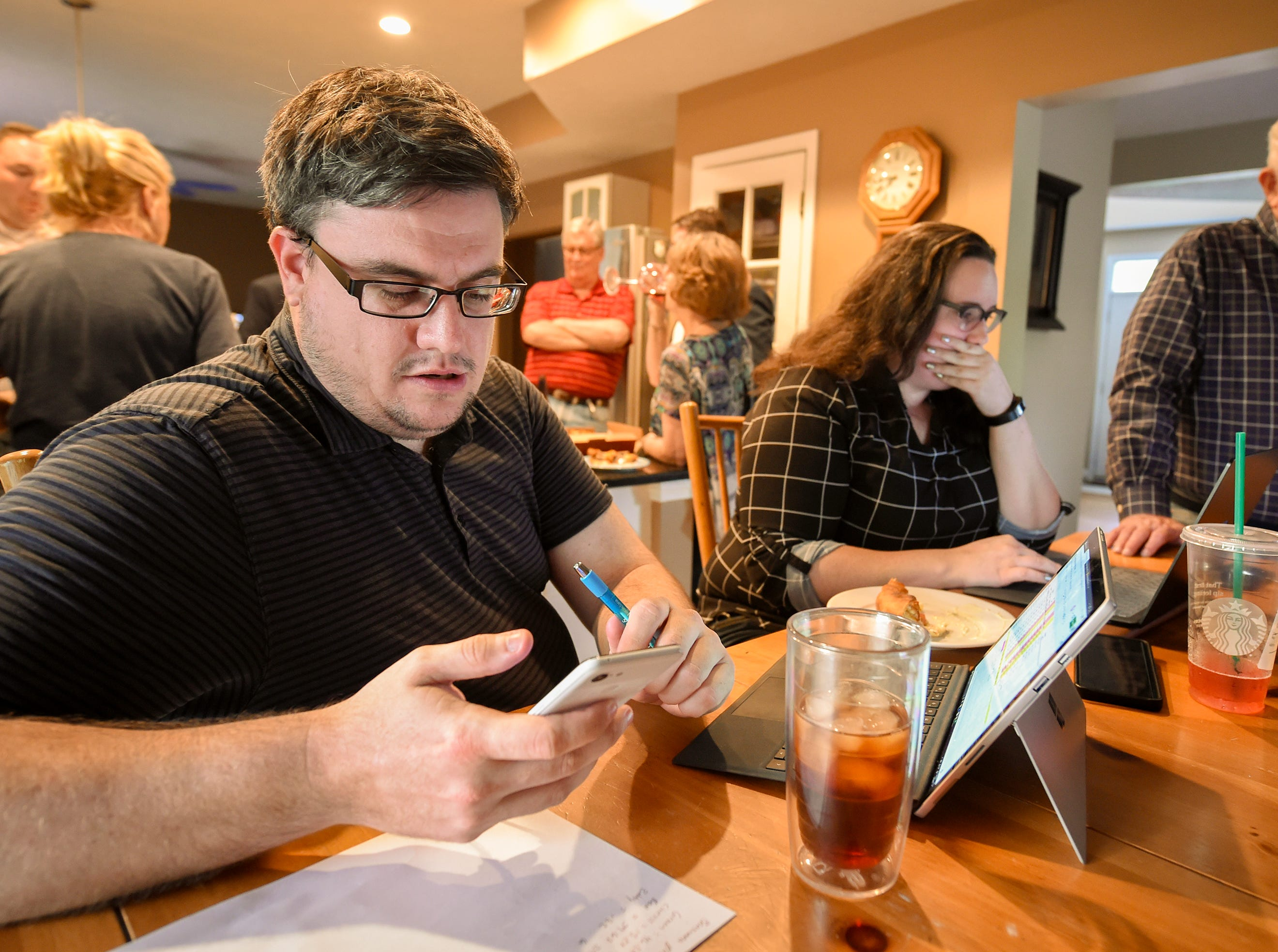 Rob Burgess, campaign manager for Fred Glynn, watches for results to come in for the Carmel mayor's race. Family, friends and supporters gathered at the home of Carmel mayoral candidate Fred Glynn as election results were publicized, Tuesday, May 7, 2019. Glynn campaigned for the office in hopes of unseating incumbent Jim Brainard who was seeking his seventh term in the office.