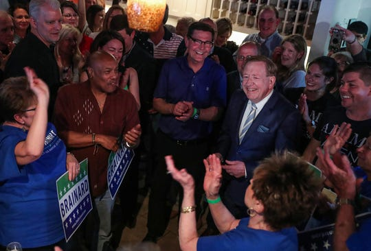 Jim Brainard celebrates as he clinches the Republican primary nomination for Carmel mayor at Donatello's Italian Restaurant.