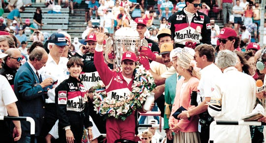 Rick Mears celebrates  after his fourth Indy 500 win at the Speedway in 1991.