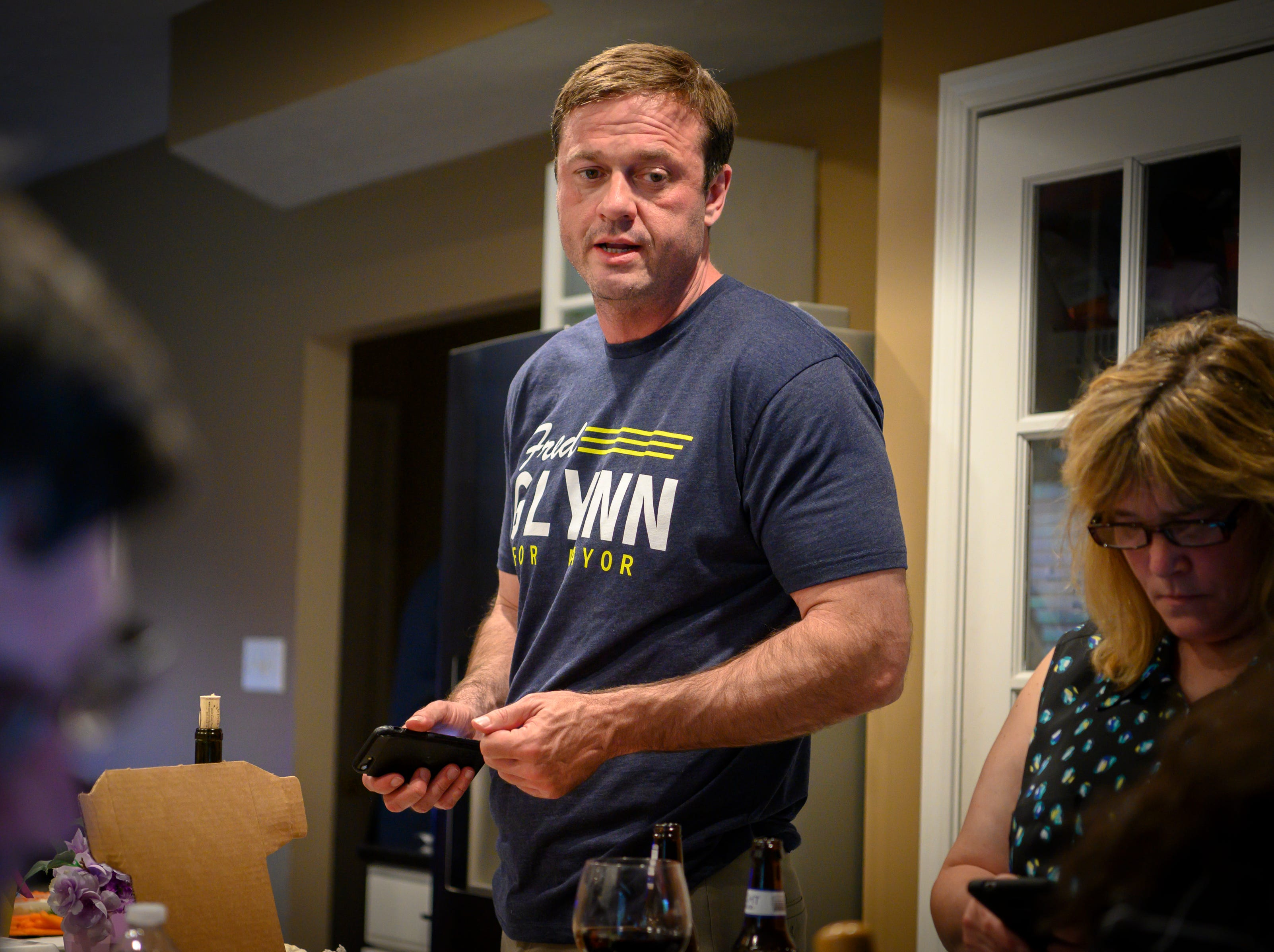 Fred Glynn talks with volunteers that are monitoring the poll results. Family, friends and supporters gathered at the home of the Carmel mayoral candidate as election results were publicized, Tuesday, May 7, 2019. Glynn campaigned for the office in hopes of unseating incumbent Jim Brainard who was seeking his seventh term in the office.