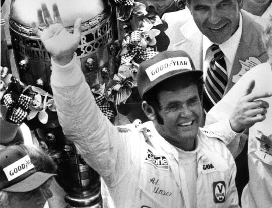 Al Unser celebrating  his third Indy 500 win in 1978.