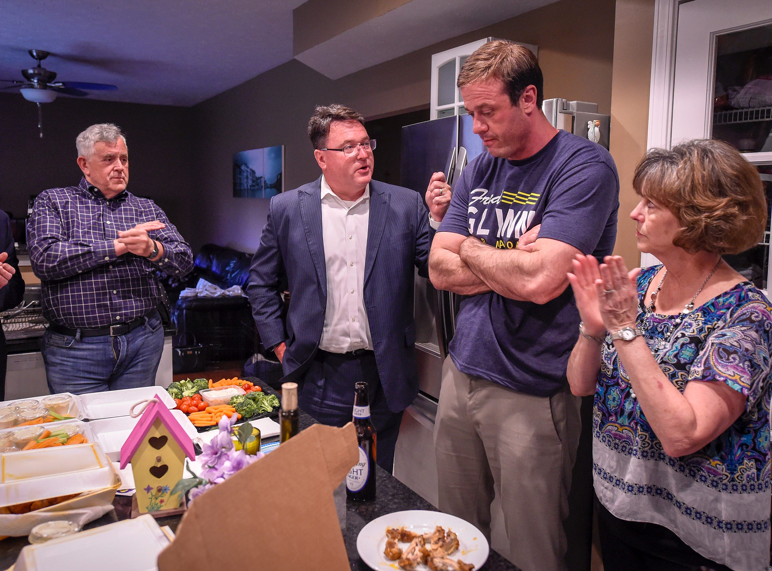 Former congressman Todd Rokita reflects on the campaign as Fred Glynn reacts to the final results of the election while in his kitchen. Family, friends and supporters gathered at the home of the Carmel mayoral candidate as election results were publicized, Tuesday, May 7, 2019. Glynn campaigned for the office in hopes of unseating incumbent Jim Brainard who was seeking his seventh term in the office.
