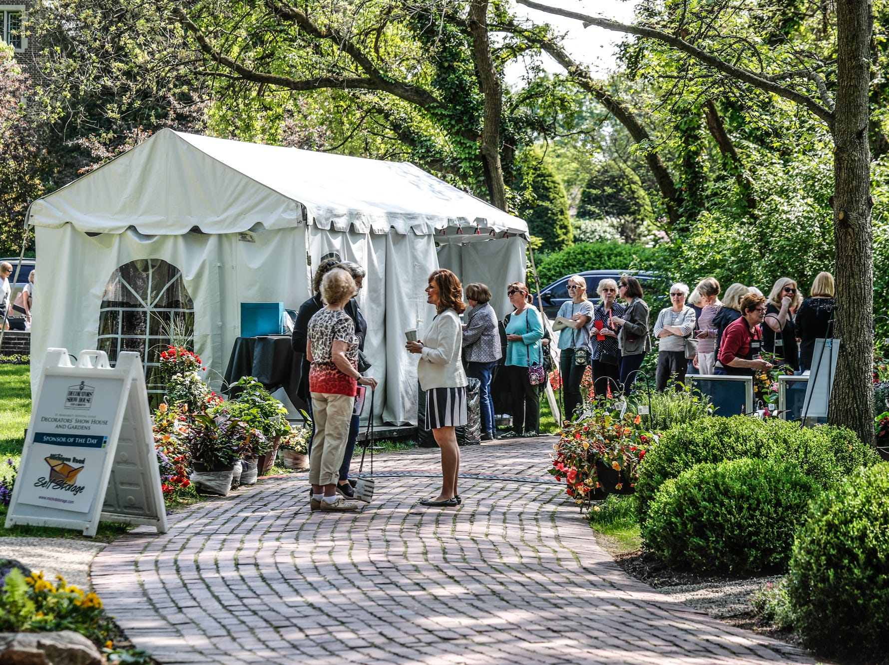 Guests line up to tour the 58th annual St. Margaret's Hospital Guild Decorators' Show House and Gardens, located at 4160 Washington Blvd., Indianapolis, on Wednesday, May 8, 2019.