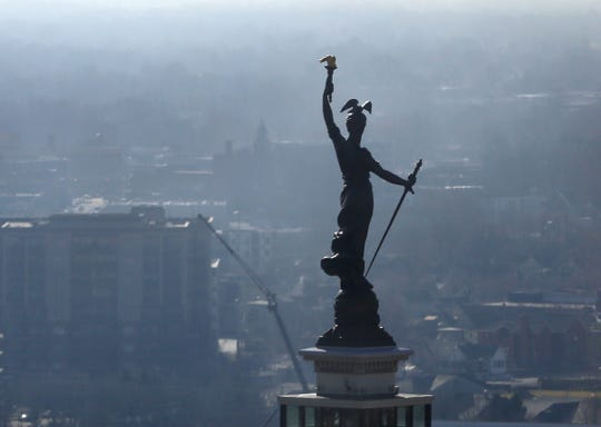 The Lady Victory statue is seen atop the Soldier's and Sailors Monument on the Circle, from the offices of Infosys at 1 America Square, Tuesday, Mar. 6, 2018.