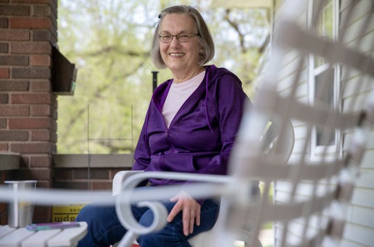 Ruth Soper, on her front porch, is a community advocate for keeping housing affordable in the area near University of Indianapolis adjacent to the new Red Line, Indianapolis, Wednesday, May 8, 2019. The new express bus line is slated to open later this Summer.