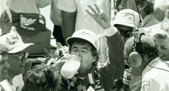 Rick Mears drinks the traditional glass of milk after winning the Indianapolis 500 in 1988 in Victory Lane