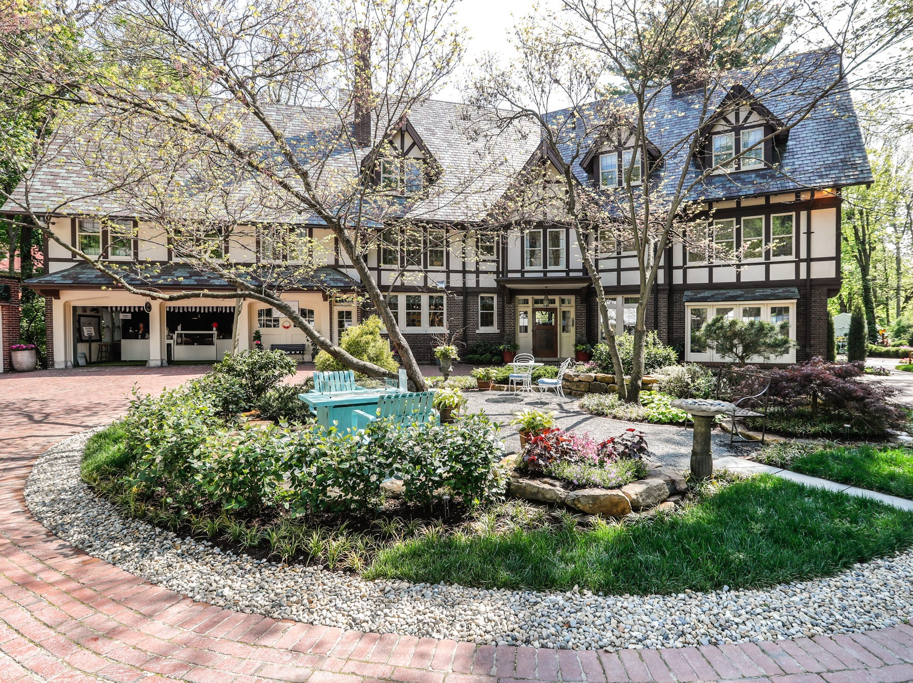 Rear view of the 58th annual St. Margaret's Hospital Guild Decorators' Show House and Gardens, located at 4160 Washington Blvd., Indianapolis, on Wednesday, May 8, 2019. The Tudor Revival home, 9,163 square feet, was also a Decorator's Show House in 1980. Built in 1919 by Clark E. Mallery and Roberta Spellman Mallery, who was a cofounder of the American Garment Company.